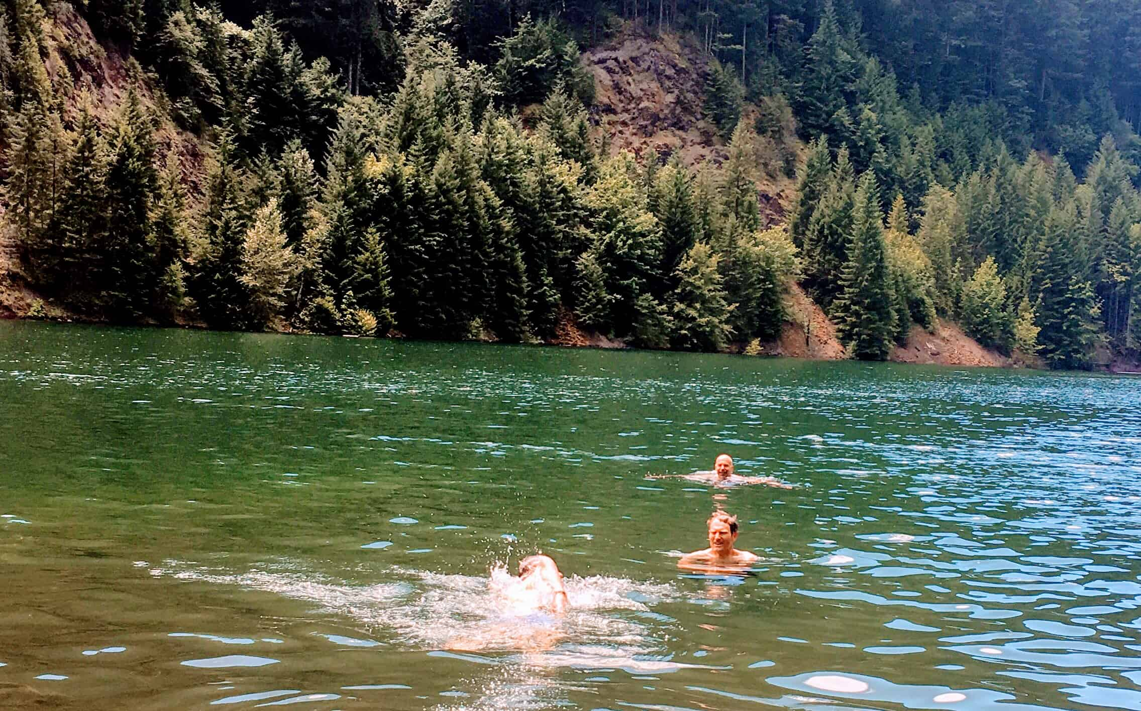Cyclists swimming in Cougar Reservoir after gravel descent