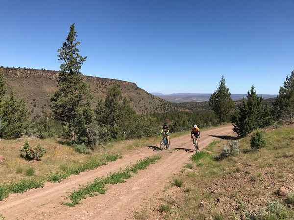 Two cyclists on Hay Creek road with punchy climb.
