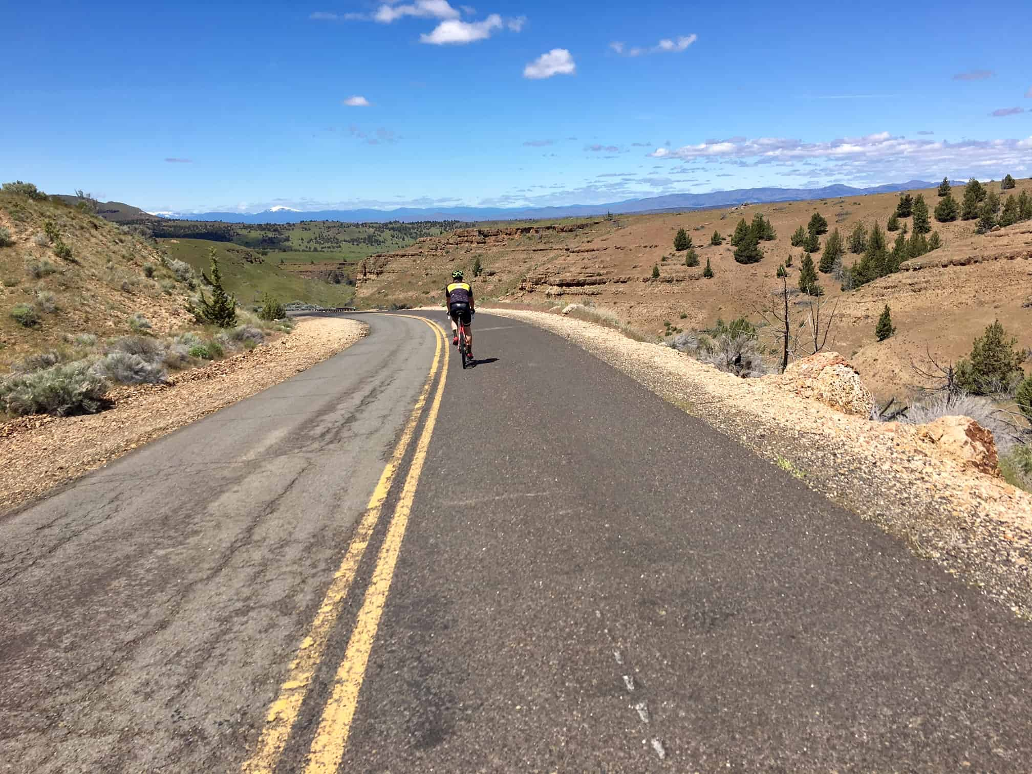 Cyclist dropping into the canyon on Pony Butte road.