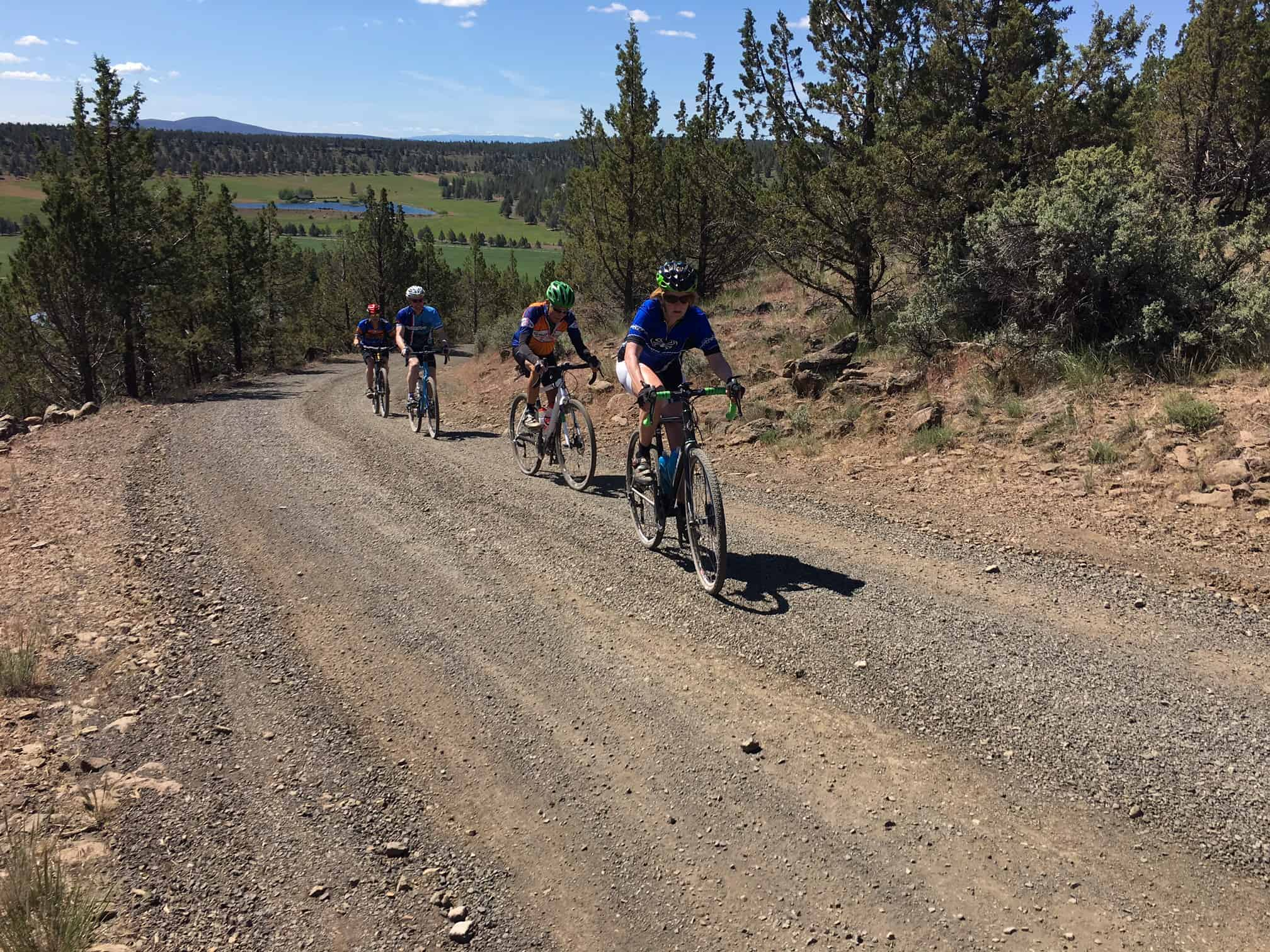 Cyclists on gravel forest road 1393 near Sisters, Oregon