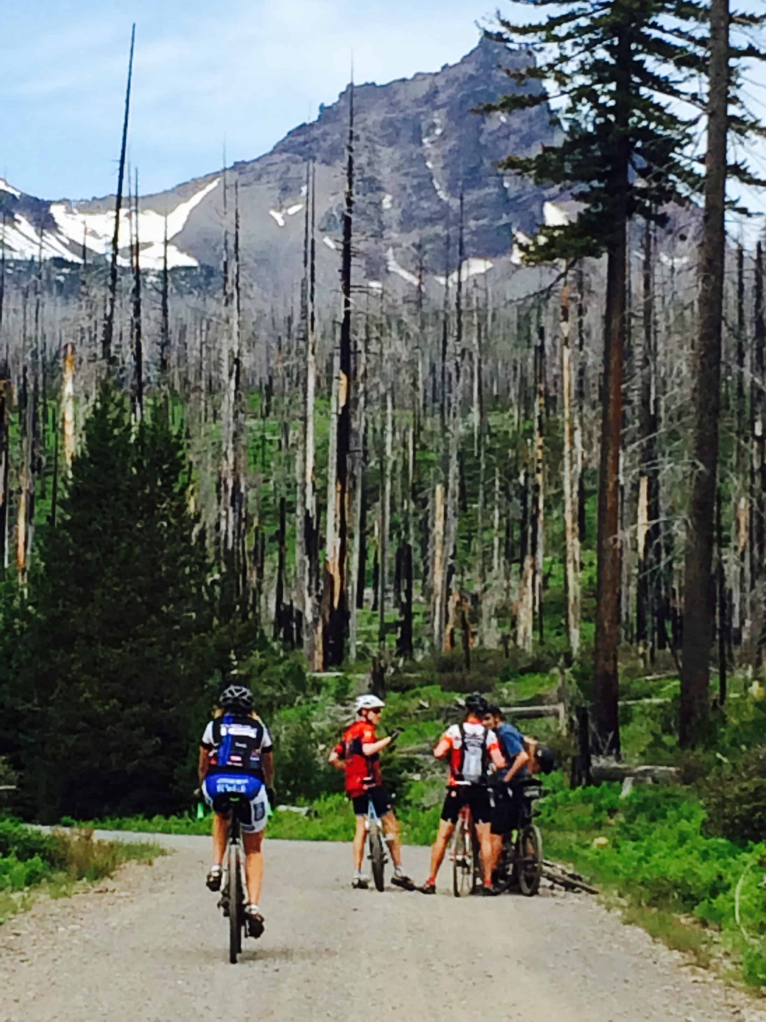 Group of cyclists on gravel near Round Lake, Oregon