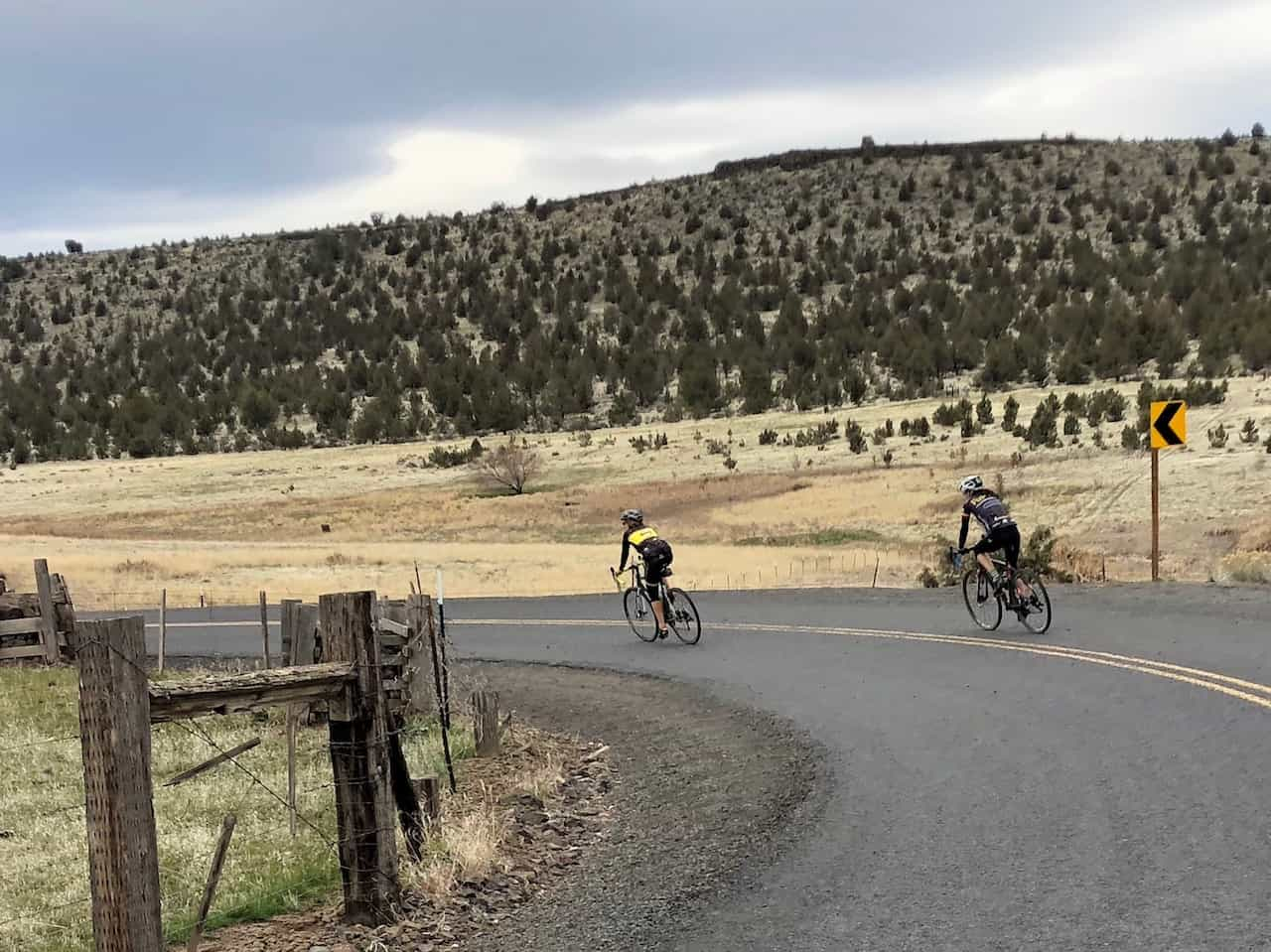 Cyclists riding into Gateway, Oregon on paved road.
