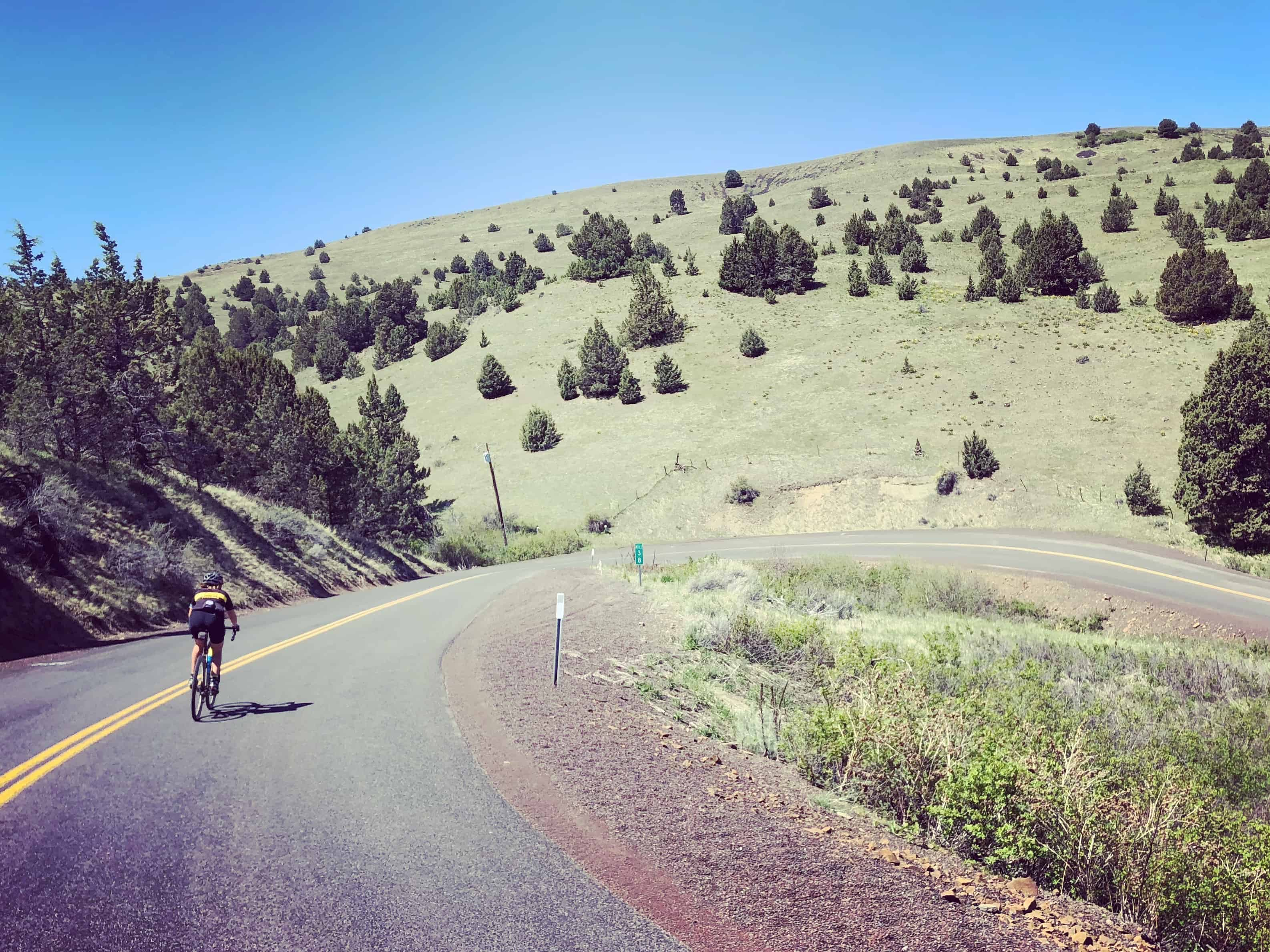 Nicyclist descending Shaniko Fossil Hwy