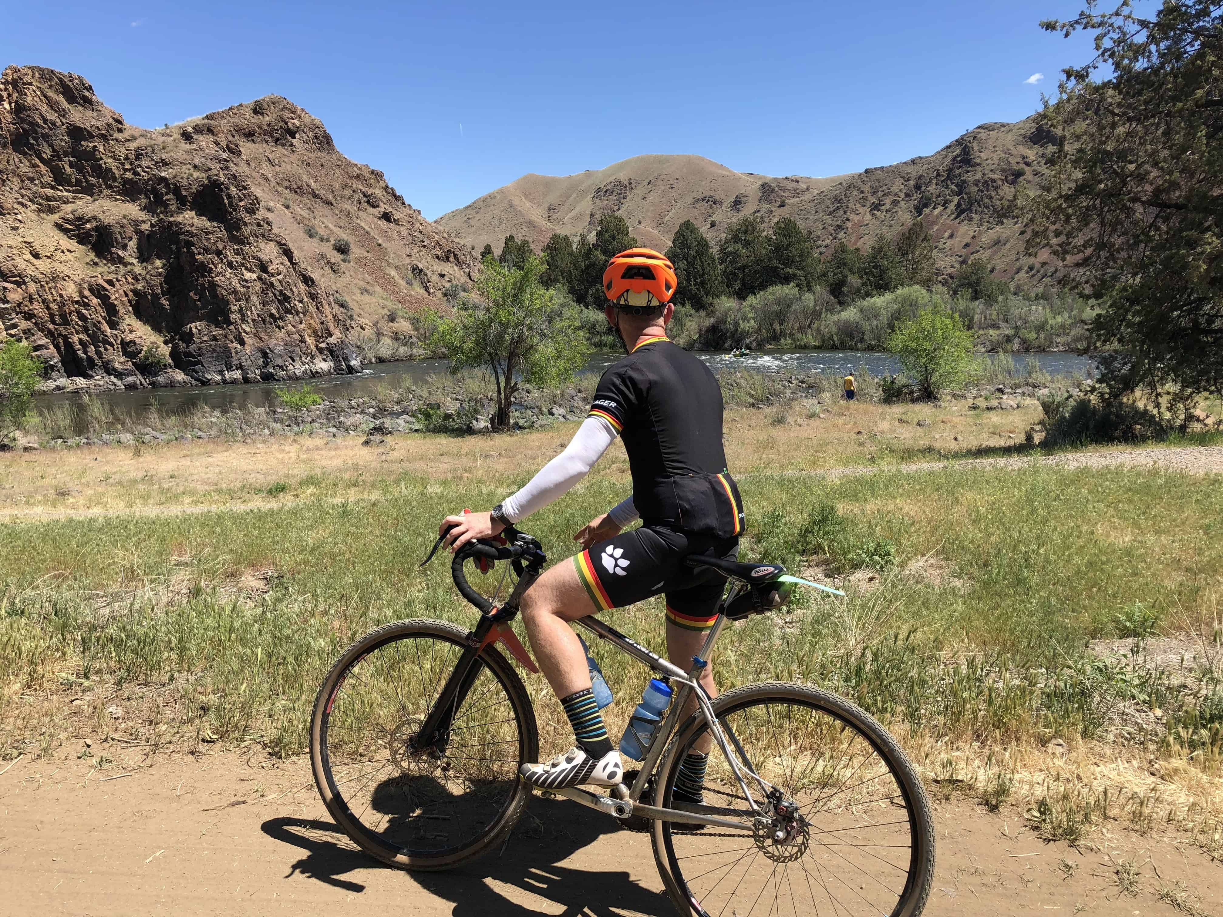 Cyclist looking at the John Day river from the Priest Hole put in.