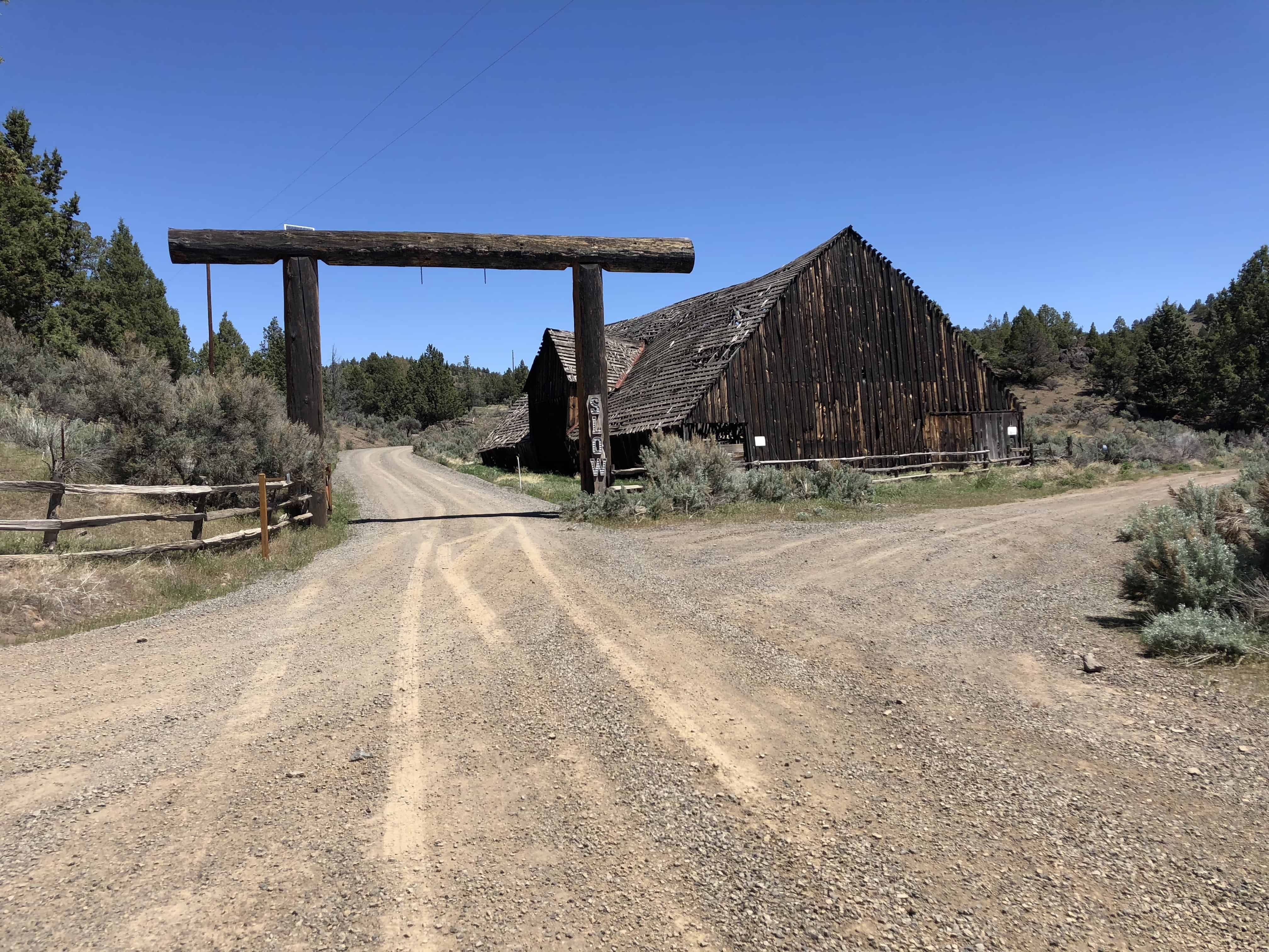 The large ranch sign at Coffelt barn off Little Bear Creek road.