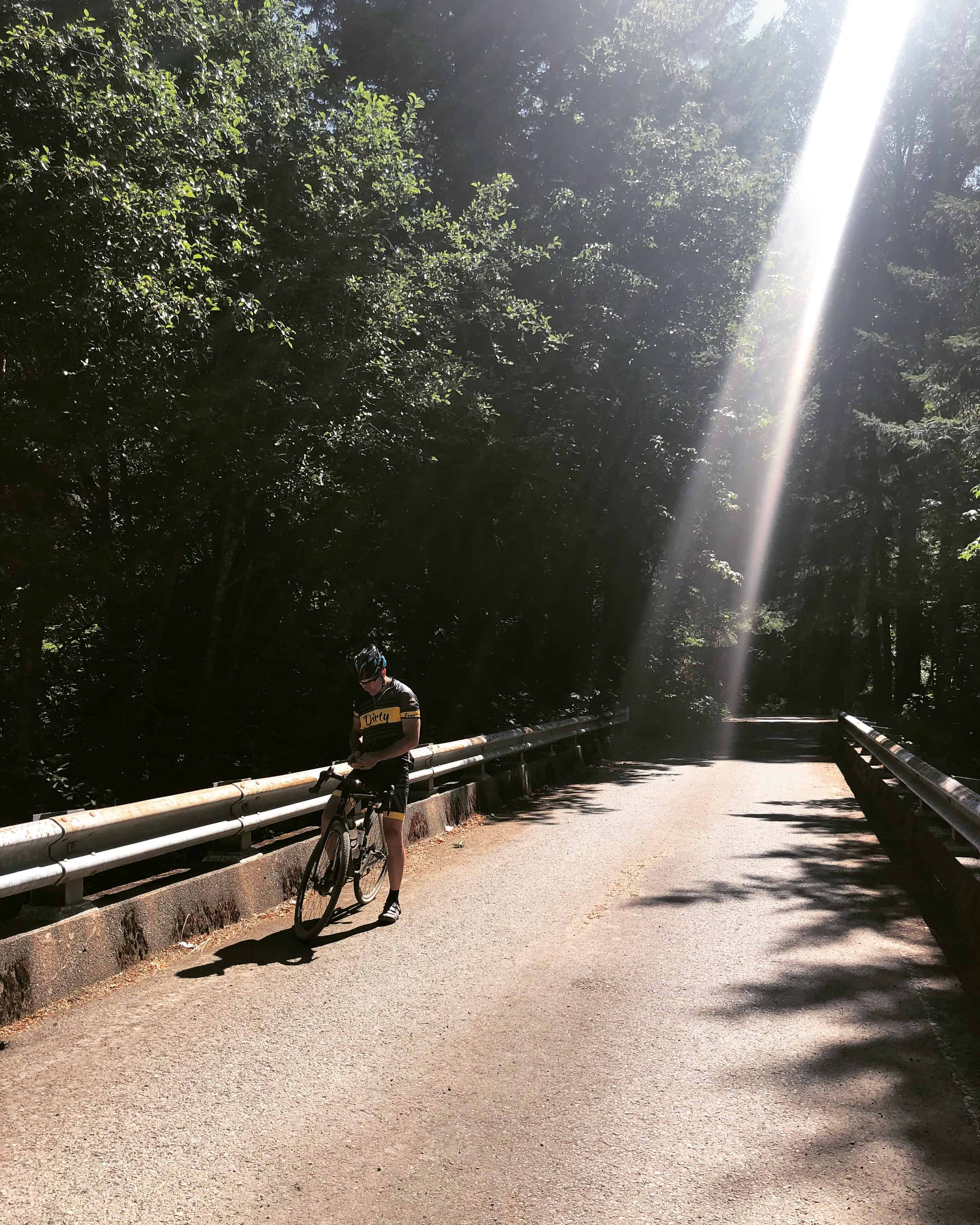 Cyclist crossing Blowout Creek, Willamette National Forest