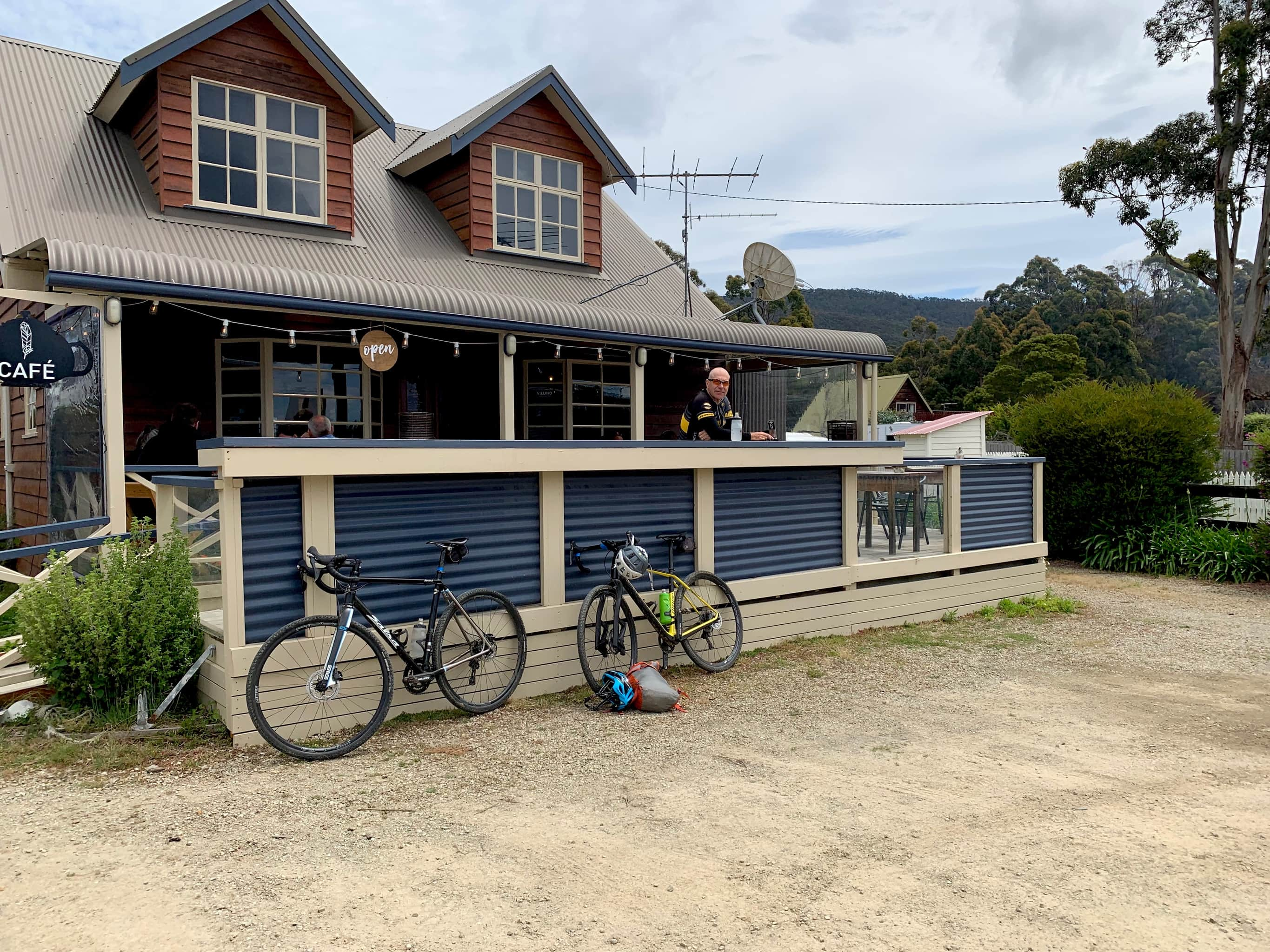 Two bikes in front of Penguin and Pardalote cafe at Adventure Bay.