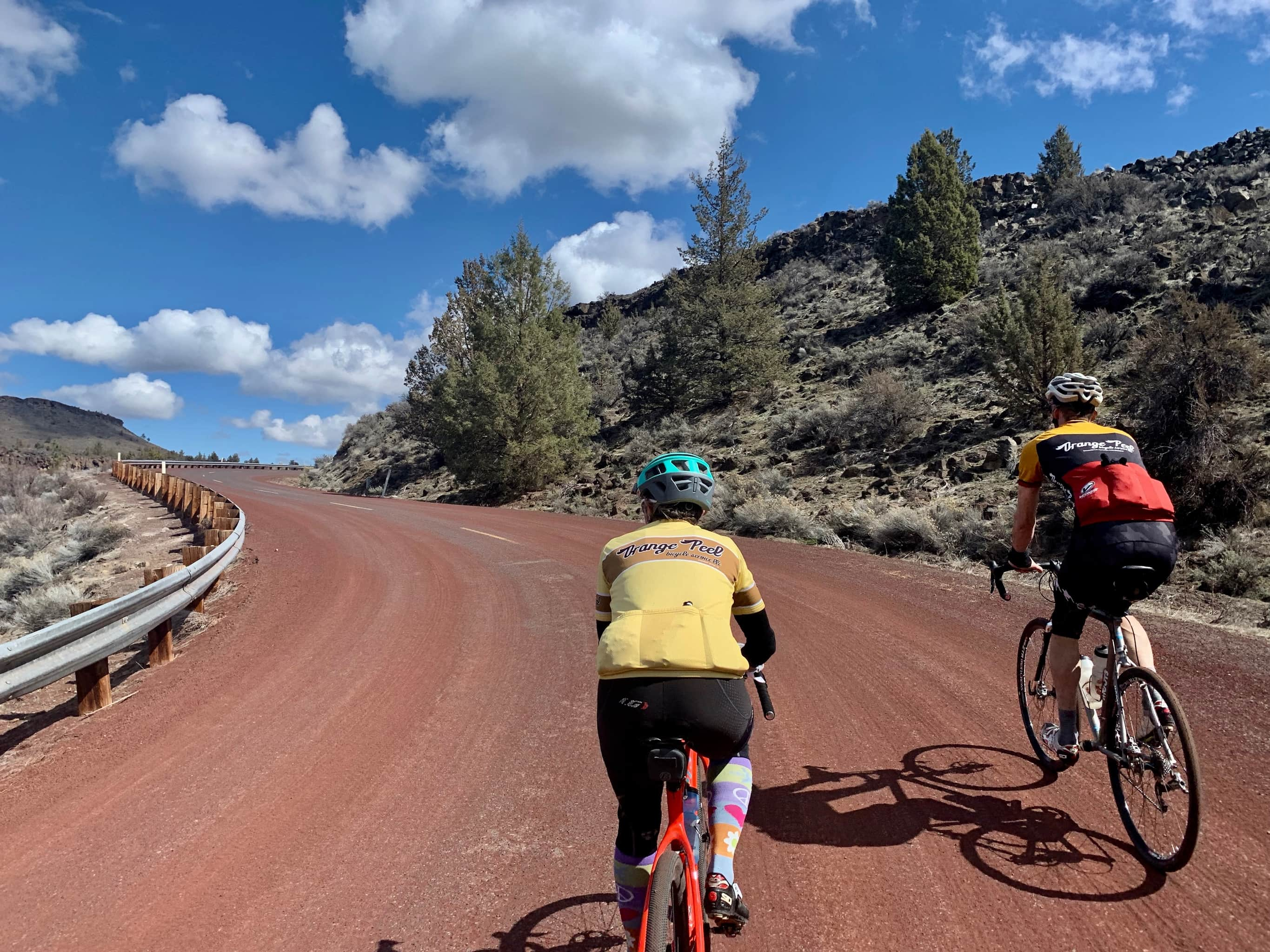 Cyclists on short, steep pitch of paved road on Warm Springs Indian reservation.