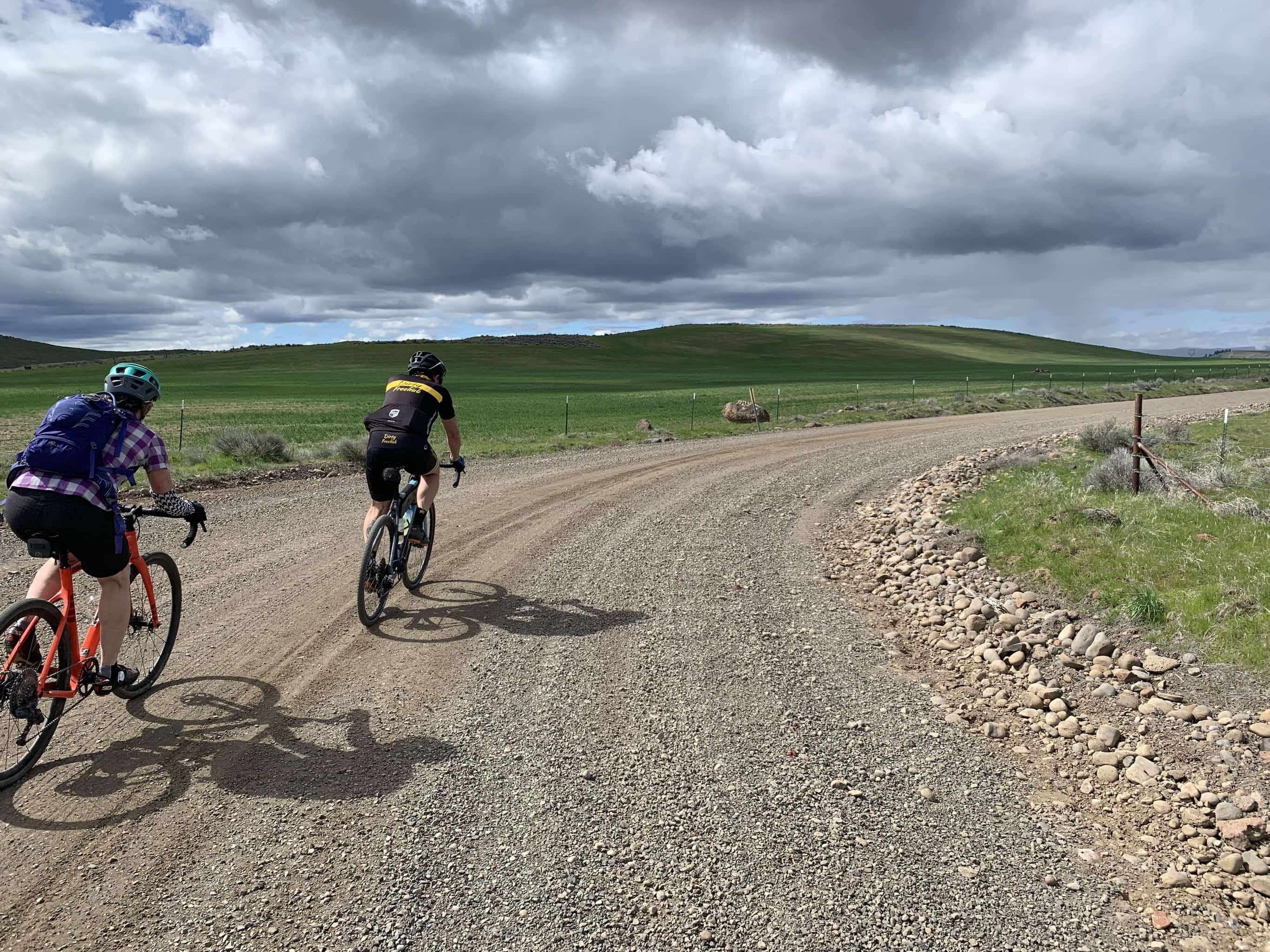 Bike riders on gravel road near Maupin, Oregon.