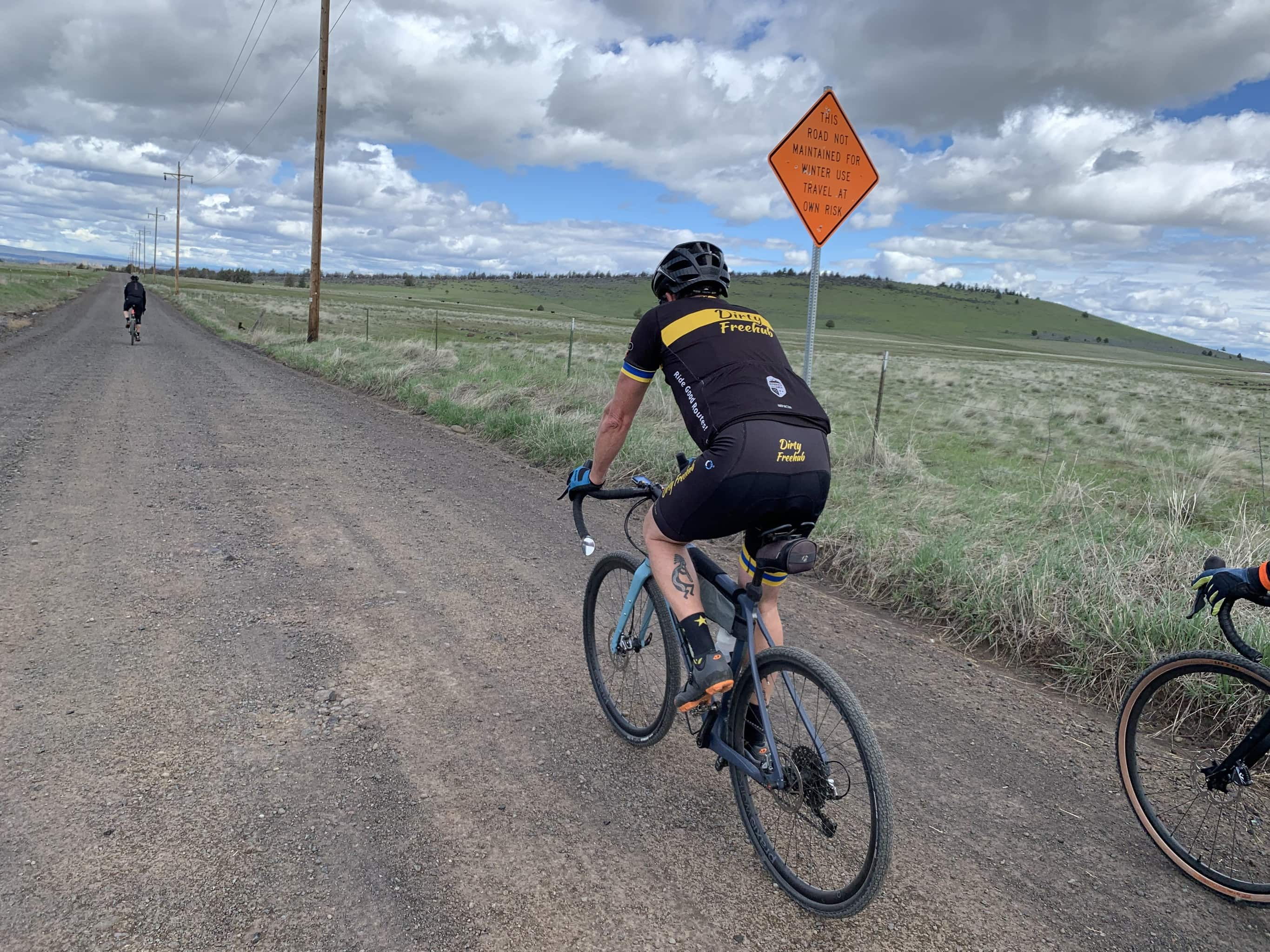 Cyclist on gravel road near the White River canyon.
