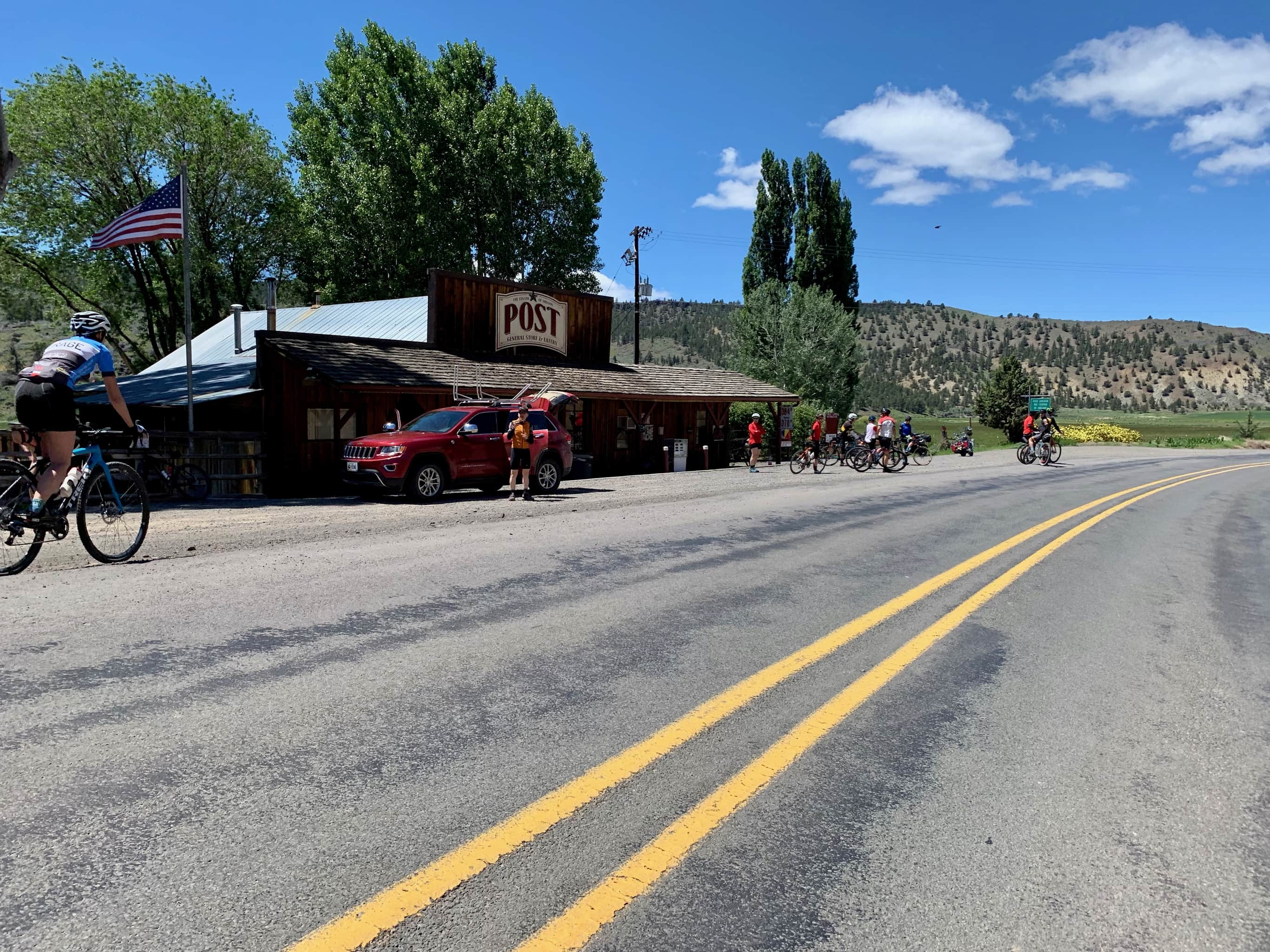 Cyclists at the Post General store.