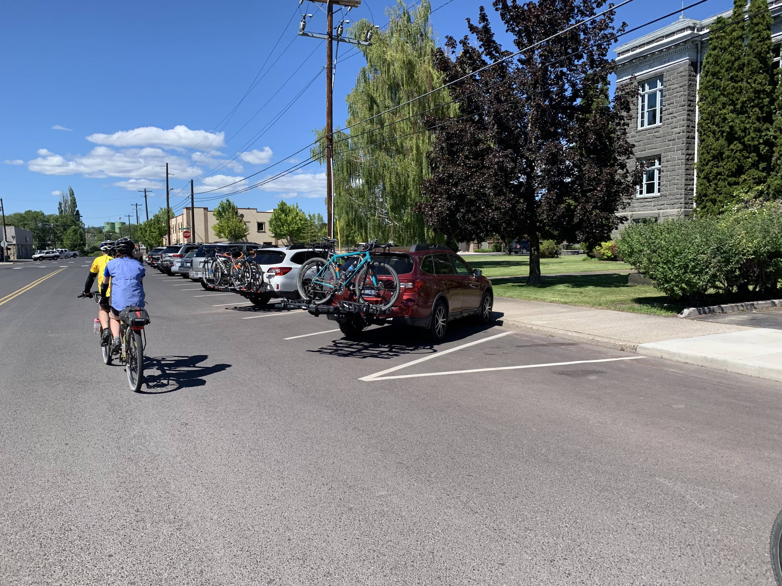 Cyclists parked near the Crook County courthouse and Good Bike Co.