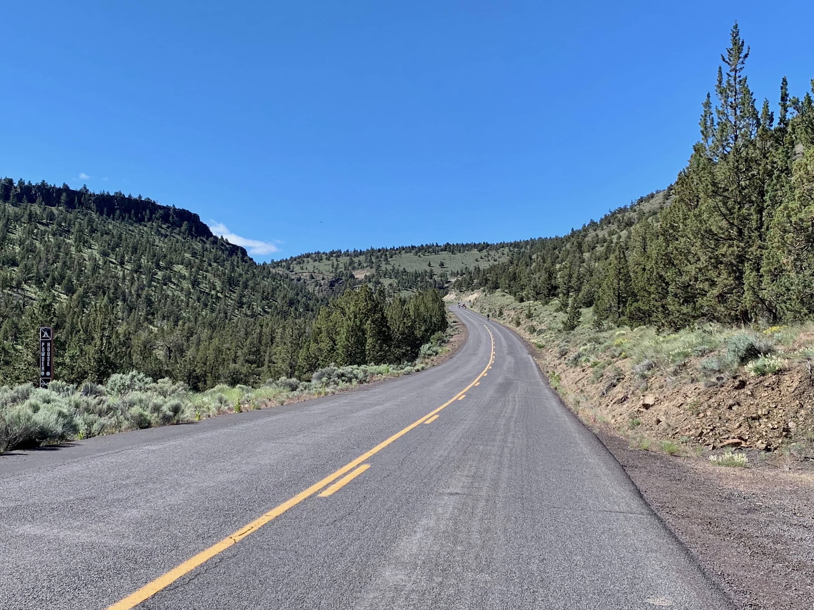 Cyclist climbing the Crooked River grade.