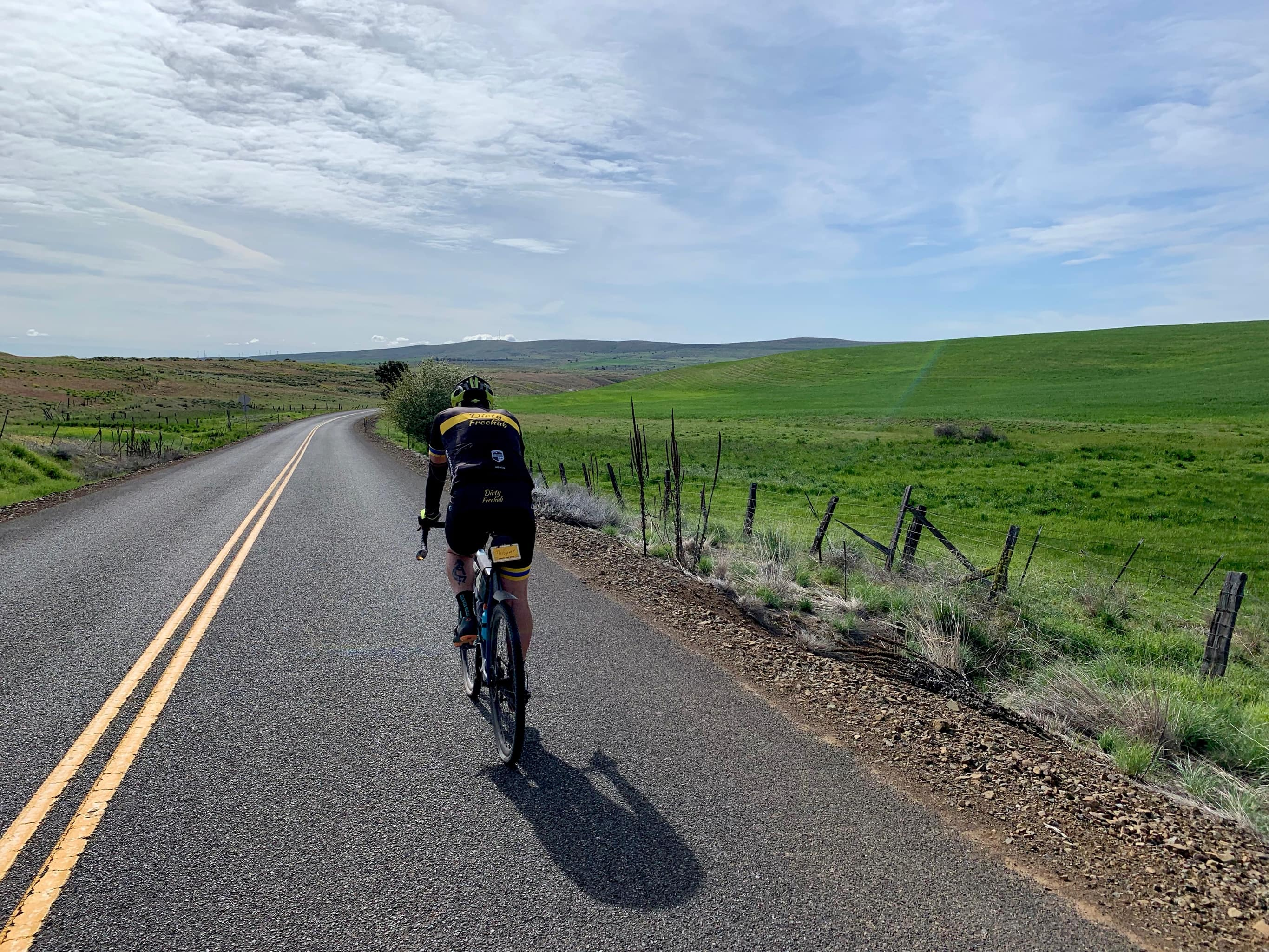 Road cyclist on leading out from Friend, Oregon.