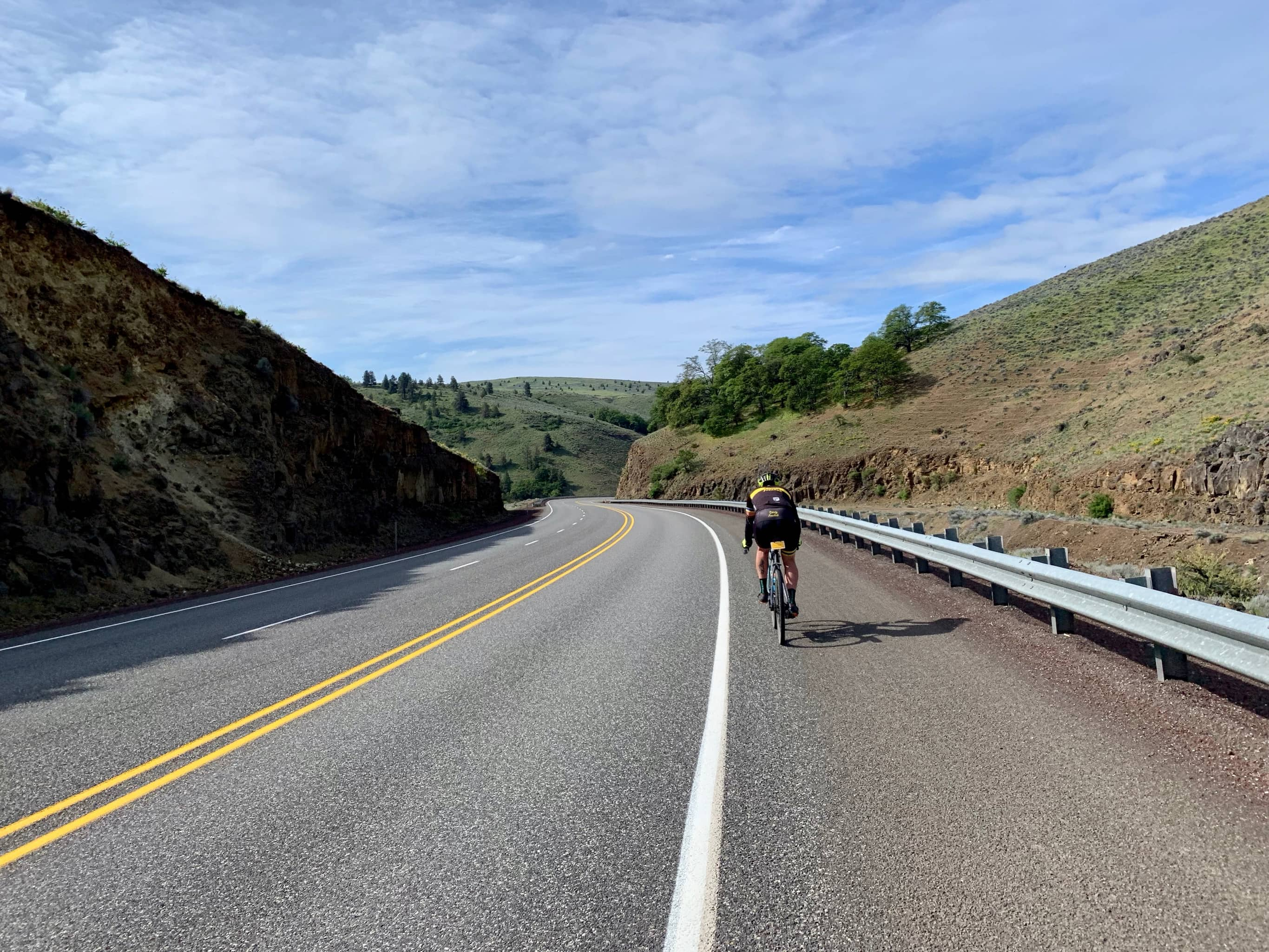 Cyclist dropping into Tygh Valley on highway 197.