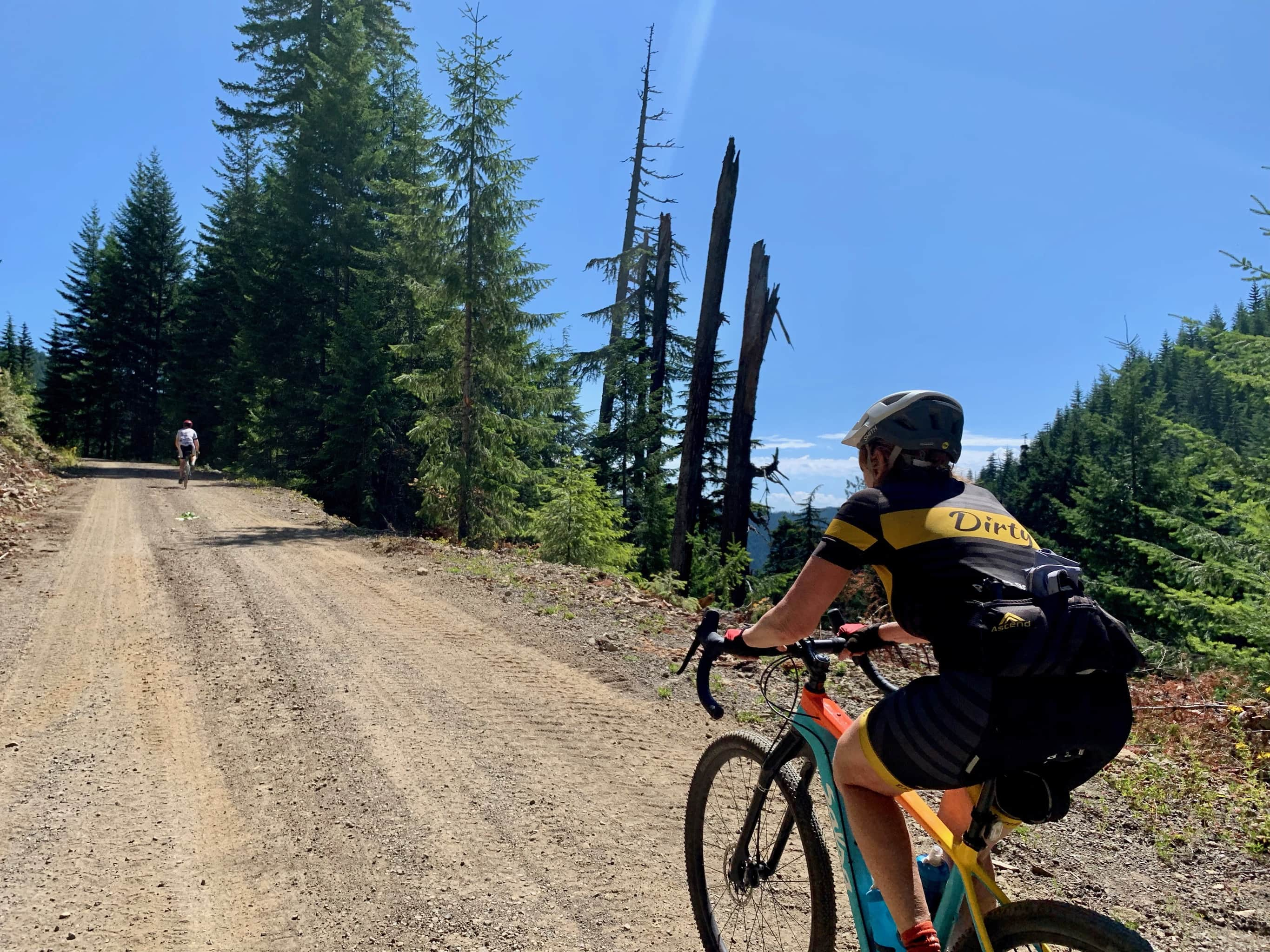 Bike rider climbing the gravel section of NF-64 in the Gifford Pinchot National Forest.