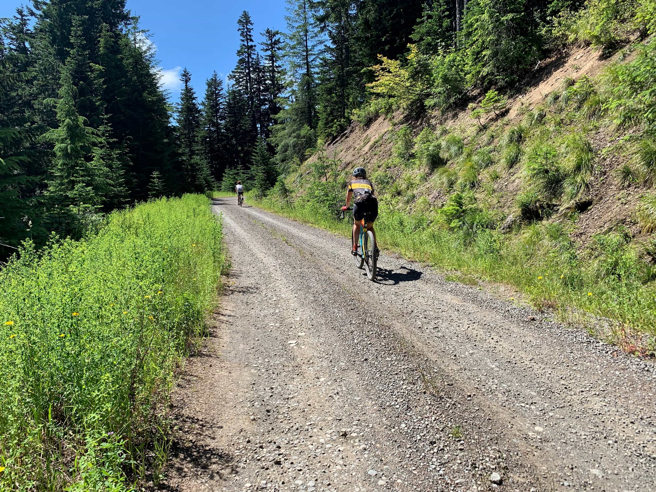 Cyclist on gravel road nearing Bare Mountain.