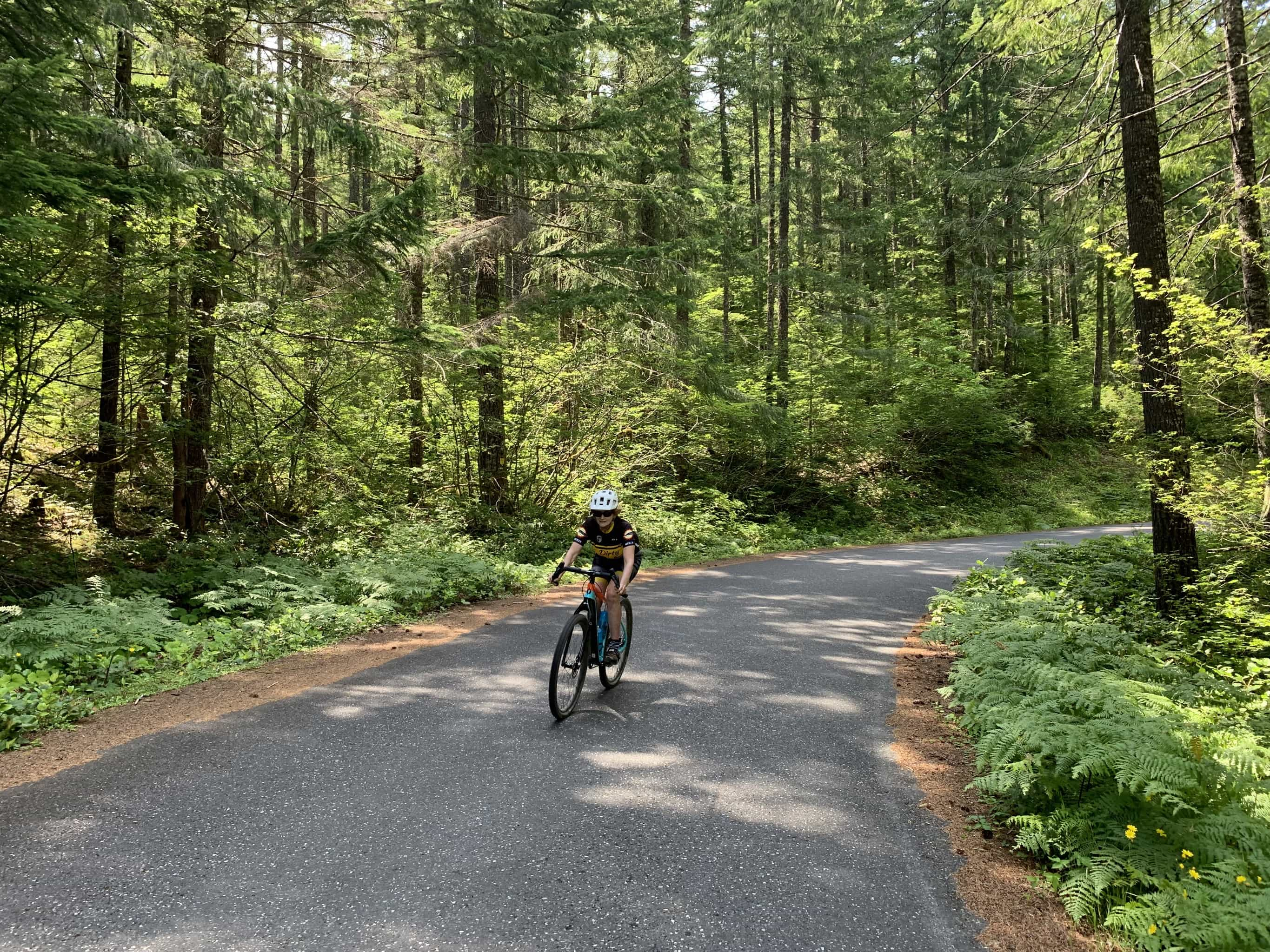 Cyclist on paved portion of NF-54 near the intersection with NF-34 near Stabler, Washington.
