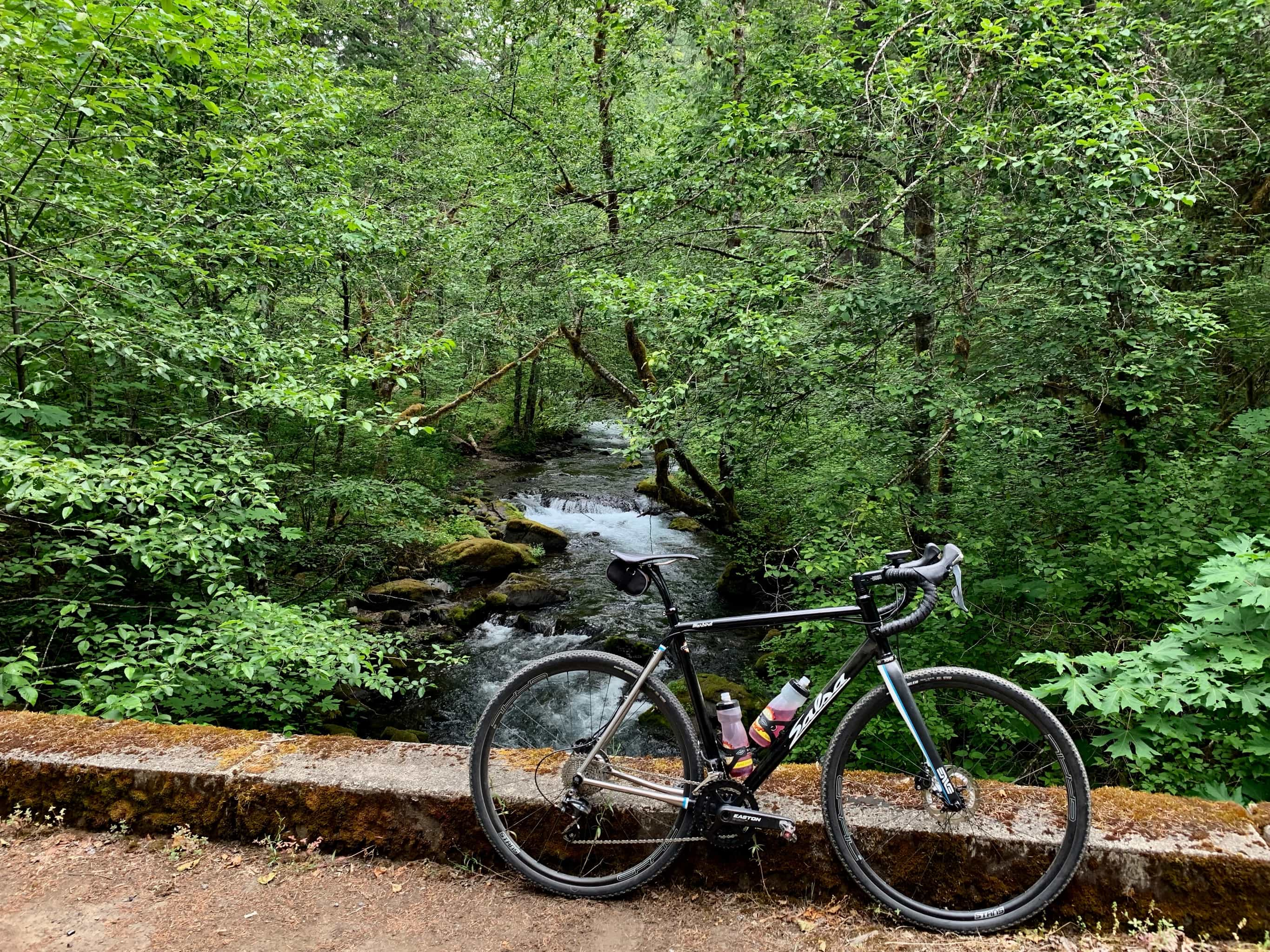 Bike on bridge at with Panther Creek in the background, near the Columbia River Gorge.
