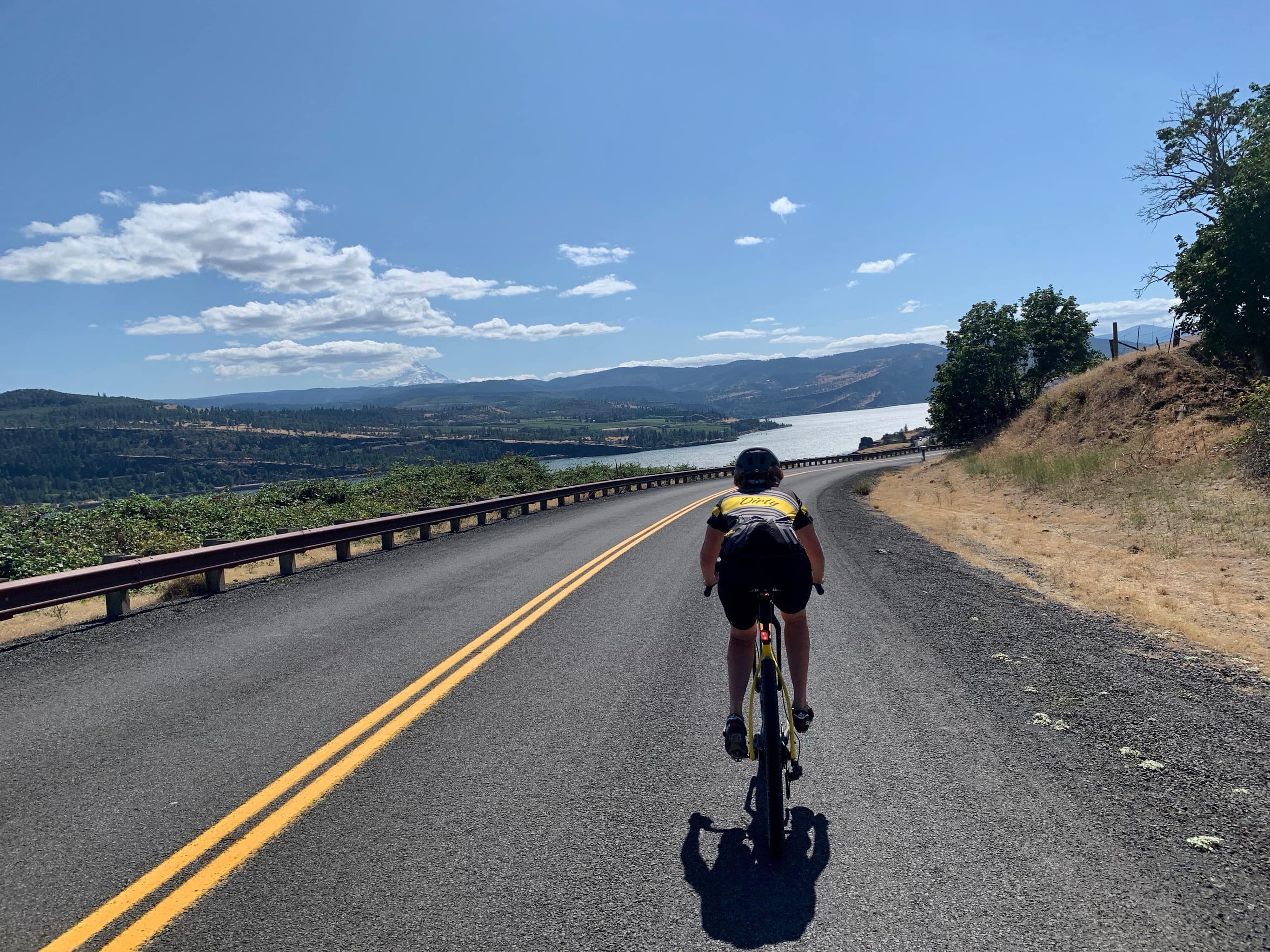 Cyclist on the paved section of Old Highway 8 along the Columbia River near Lyle, Washington.