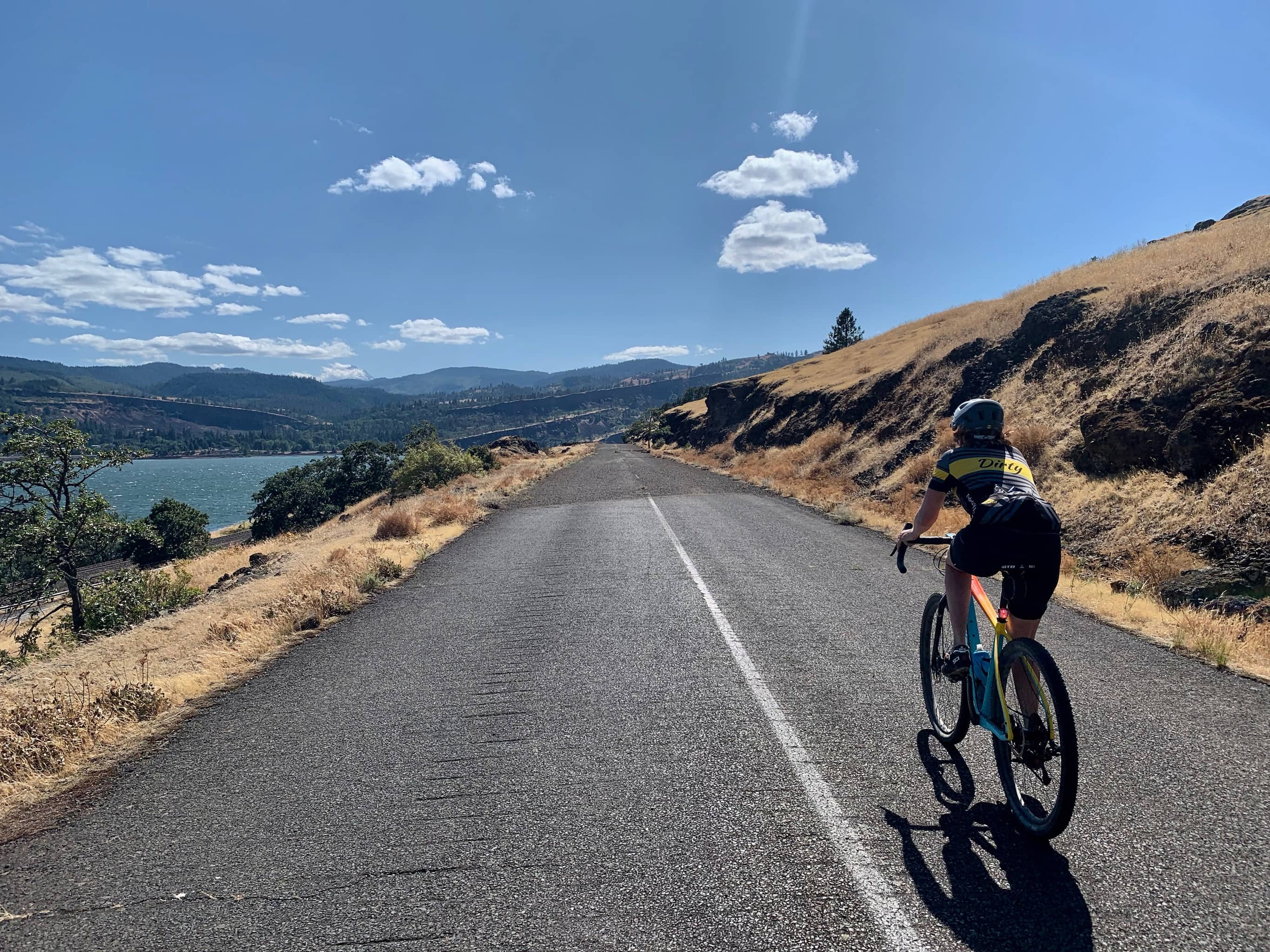 Cyclist on the trail section of Old Highway 8 along the Columbia River.