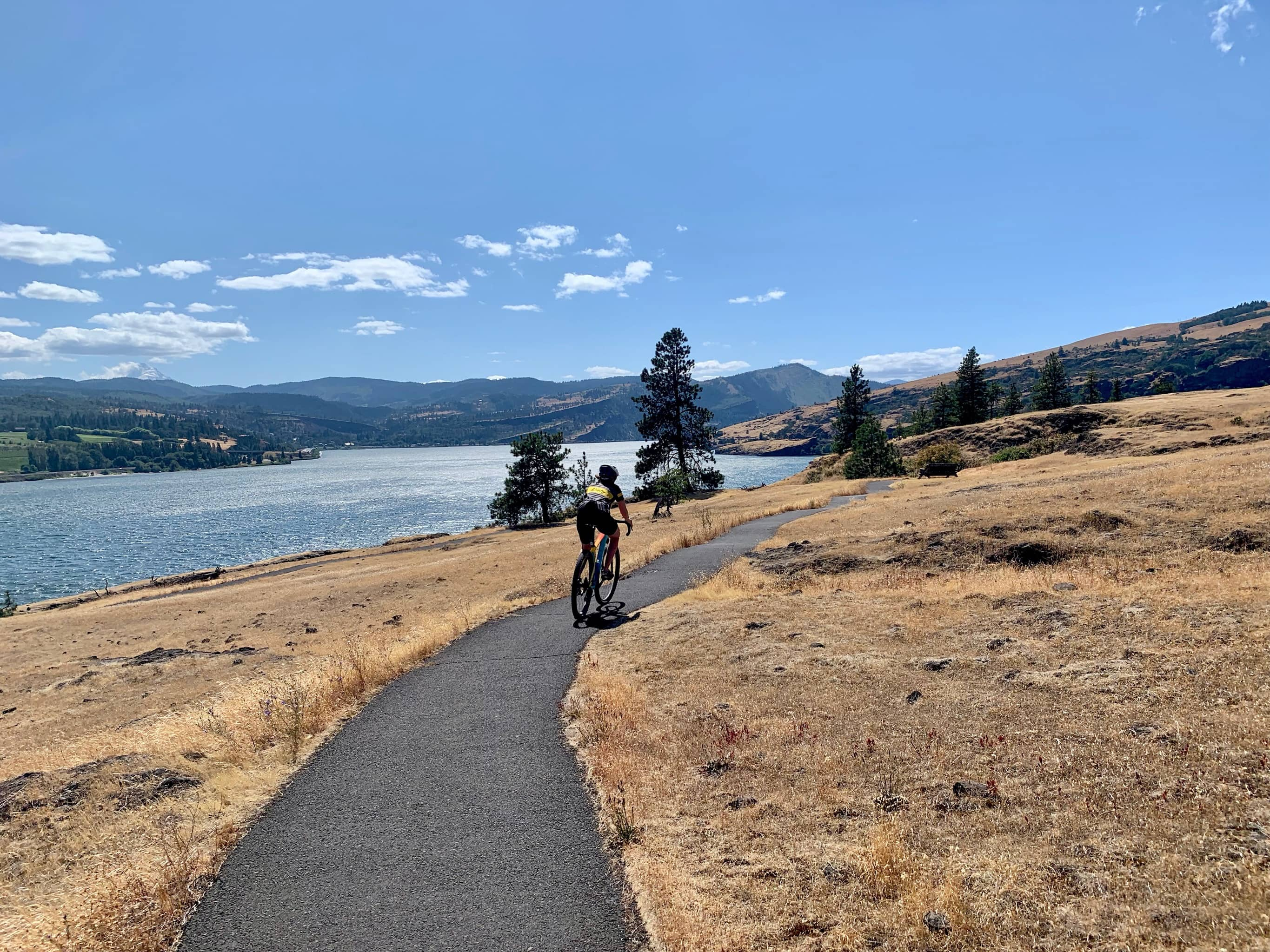Cyclist riding the paved Catherine Creek trails in the Columbia River Gorge National Scenic area.