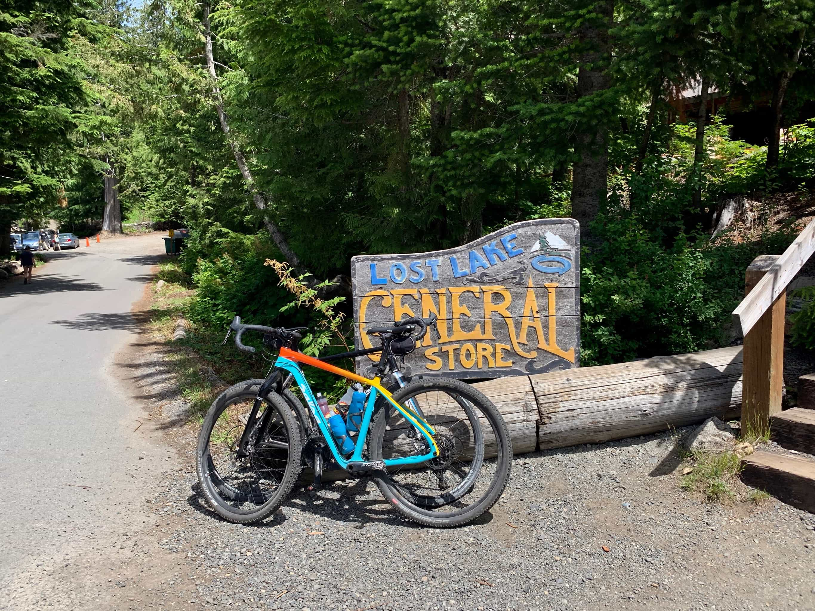 Gravel bikes parked near sign for Lost Lake General store.