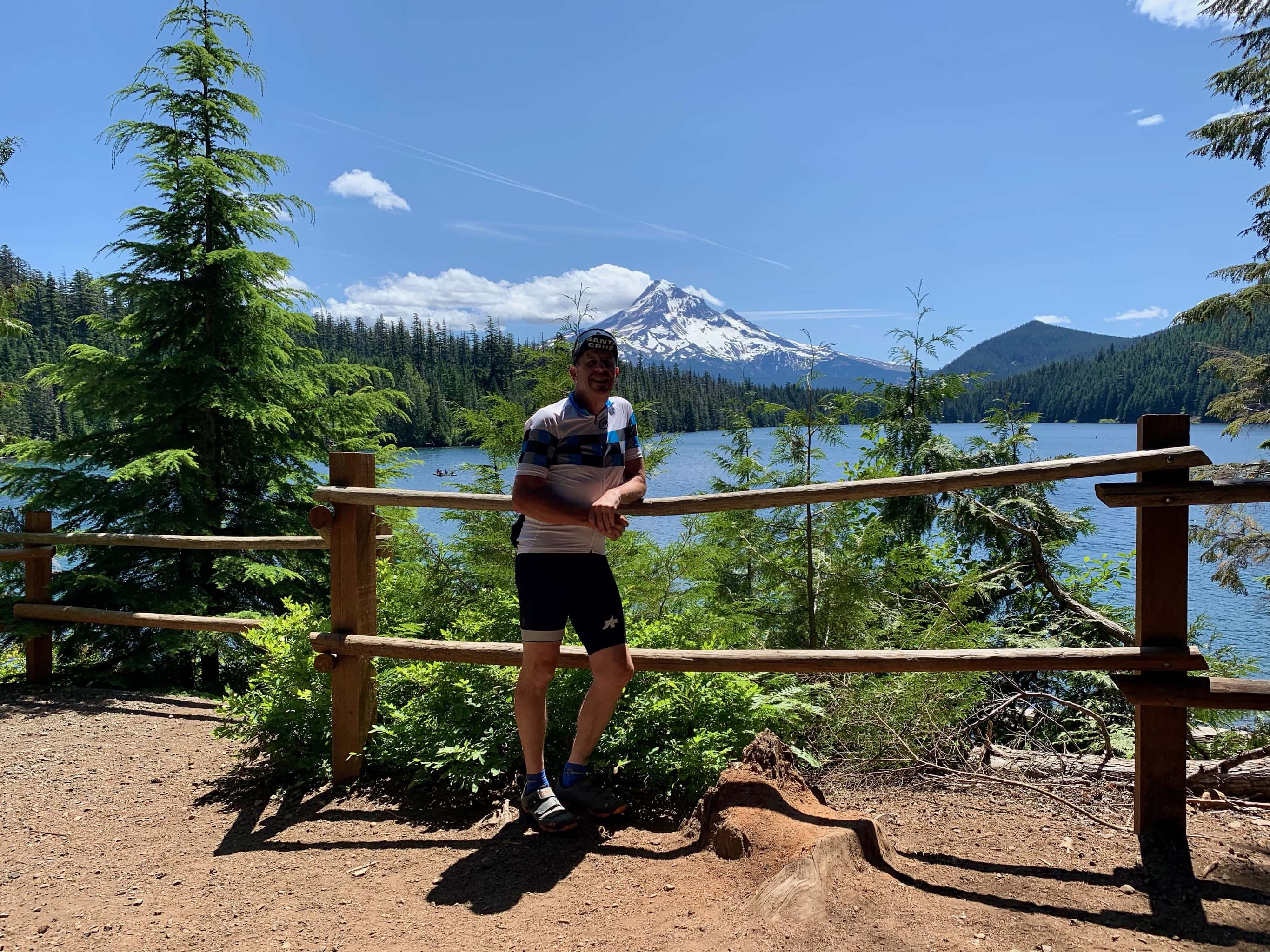 Gravel cyclist with Lost Lake and Mt. Hood in background.