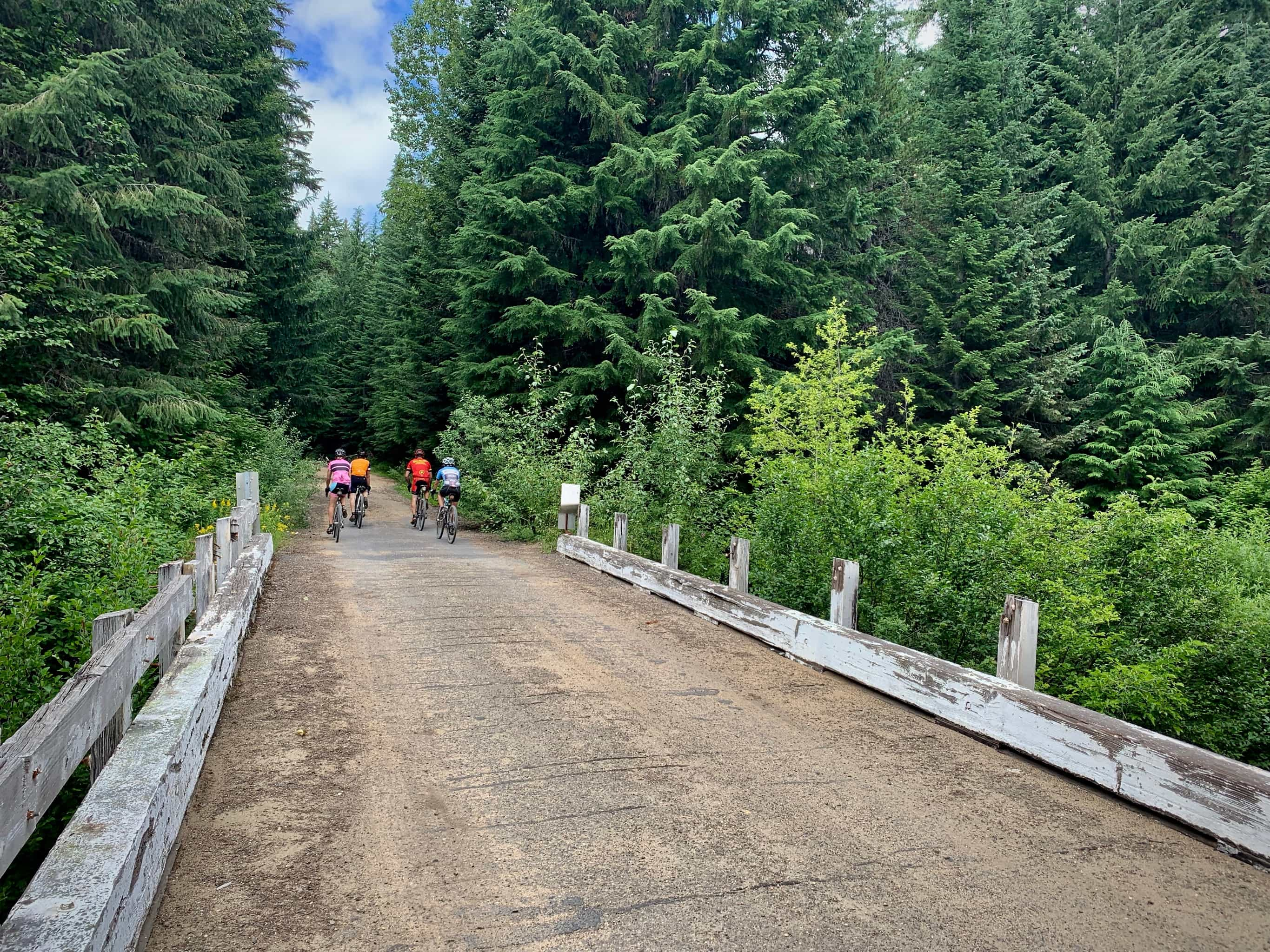 Cyclists on gravel road on the north side of South Prairie and the Big Lava Bed in Washington state.