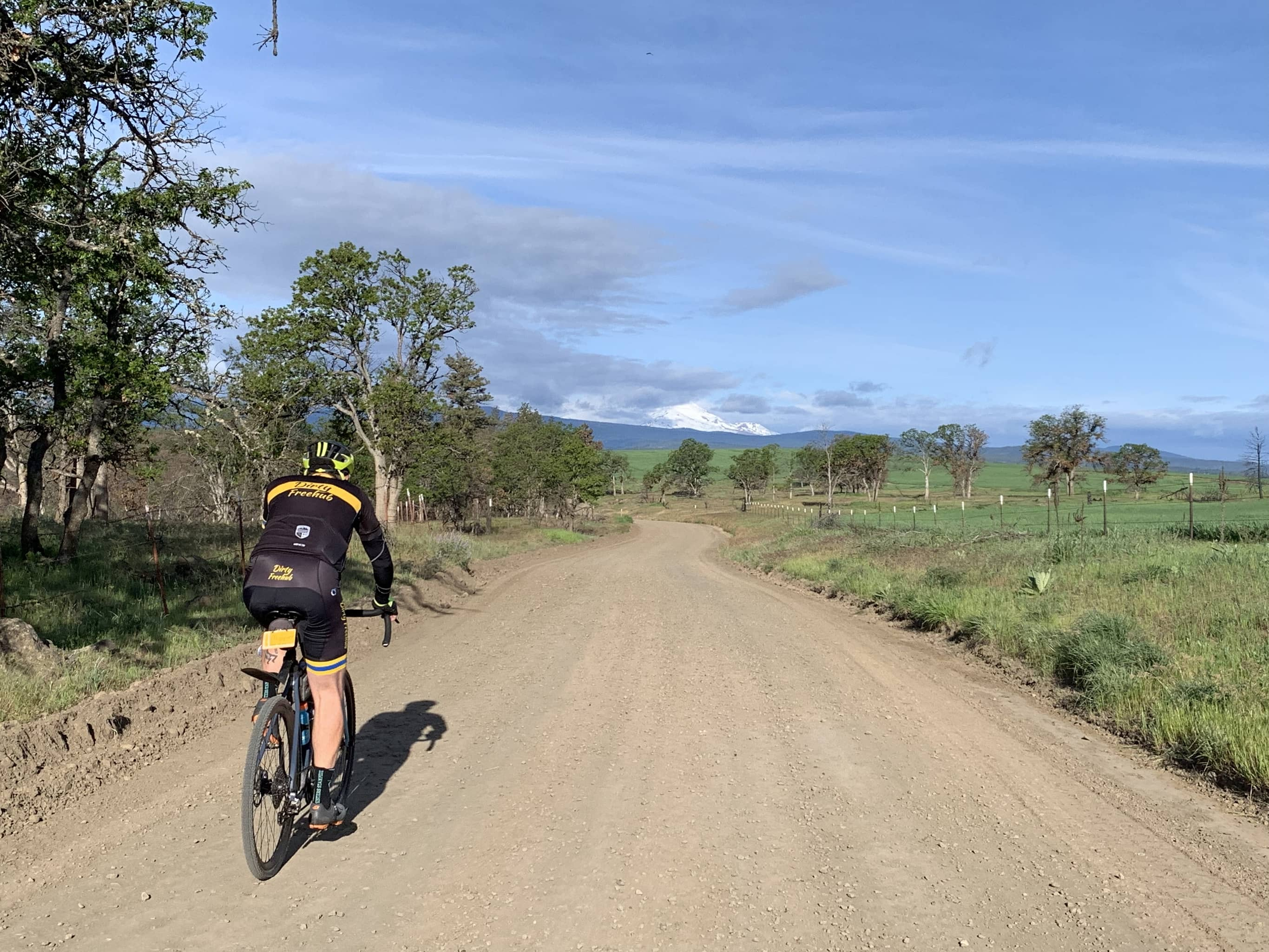 Gravel cyclist heading west with Mt. Hood in the background, near Friend, Oregon.