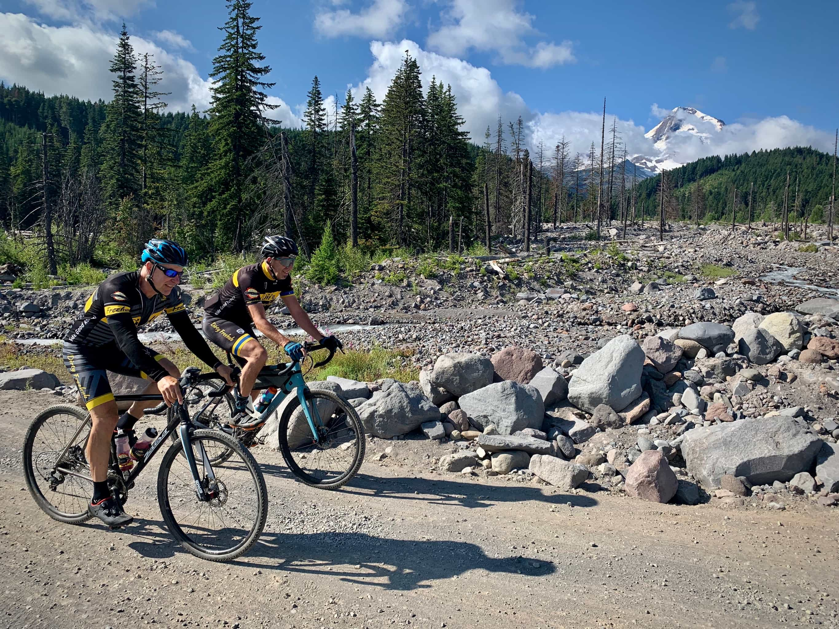 Cyclists crossing over washed out section of Laurance Lake road near Parkdale, Oregon.