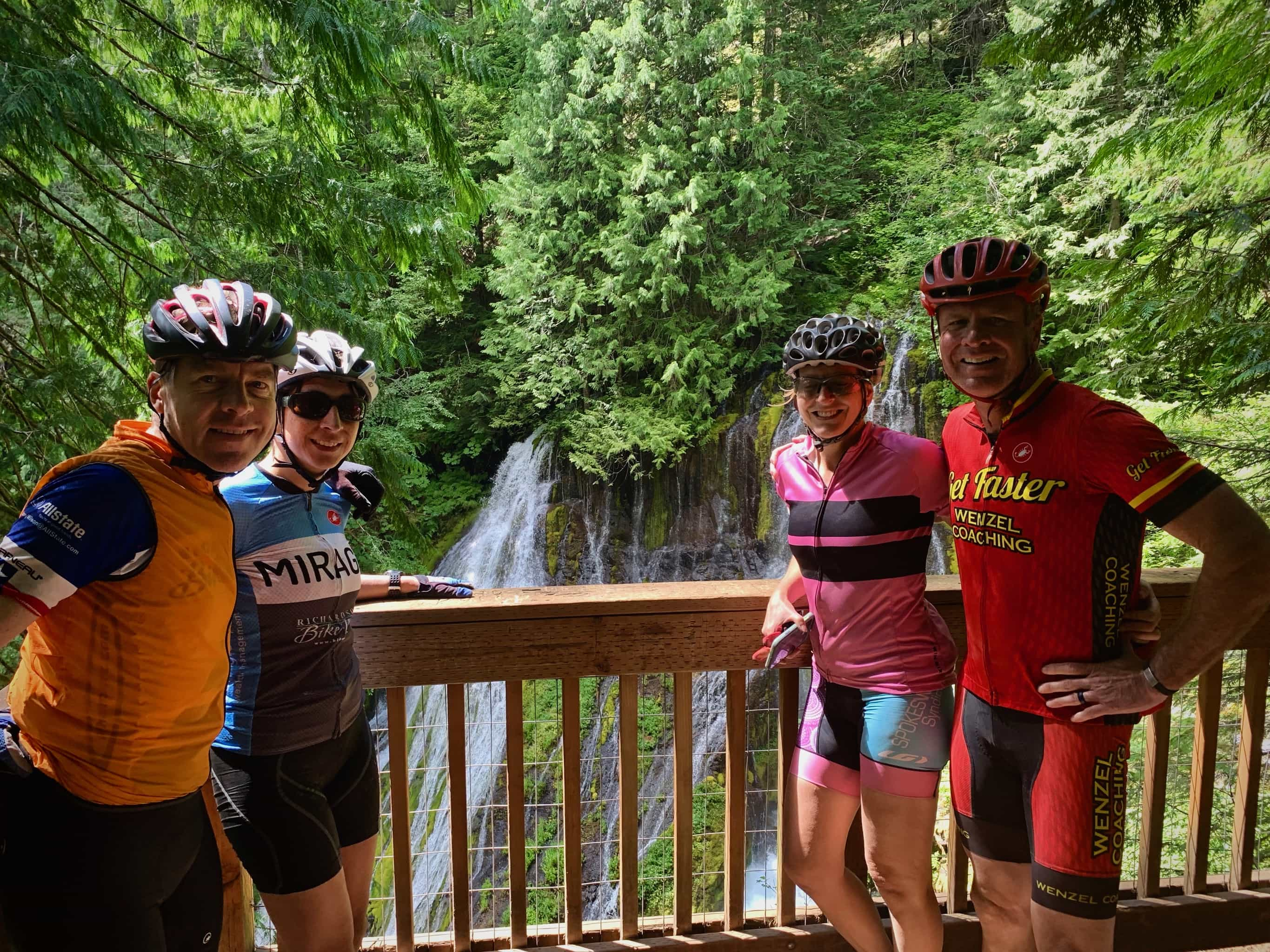 Cyclists taking in the views at Panther Creek Falls in Gifford Pinchot National forest.