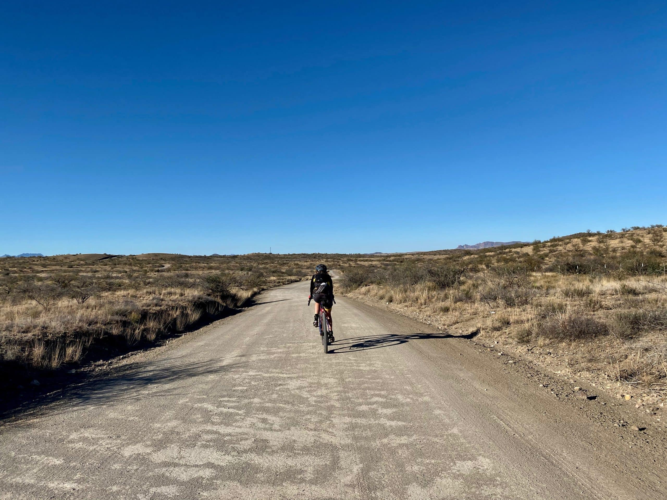 Cyclist on the gravel section of Ruby Road near Nogales, Arizona.