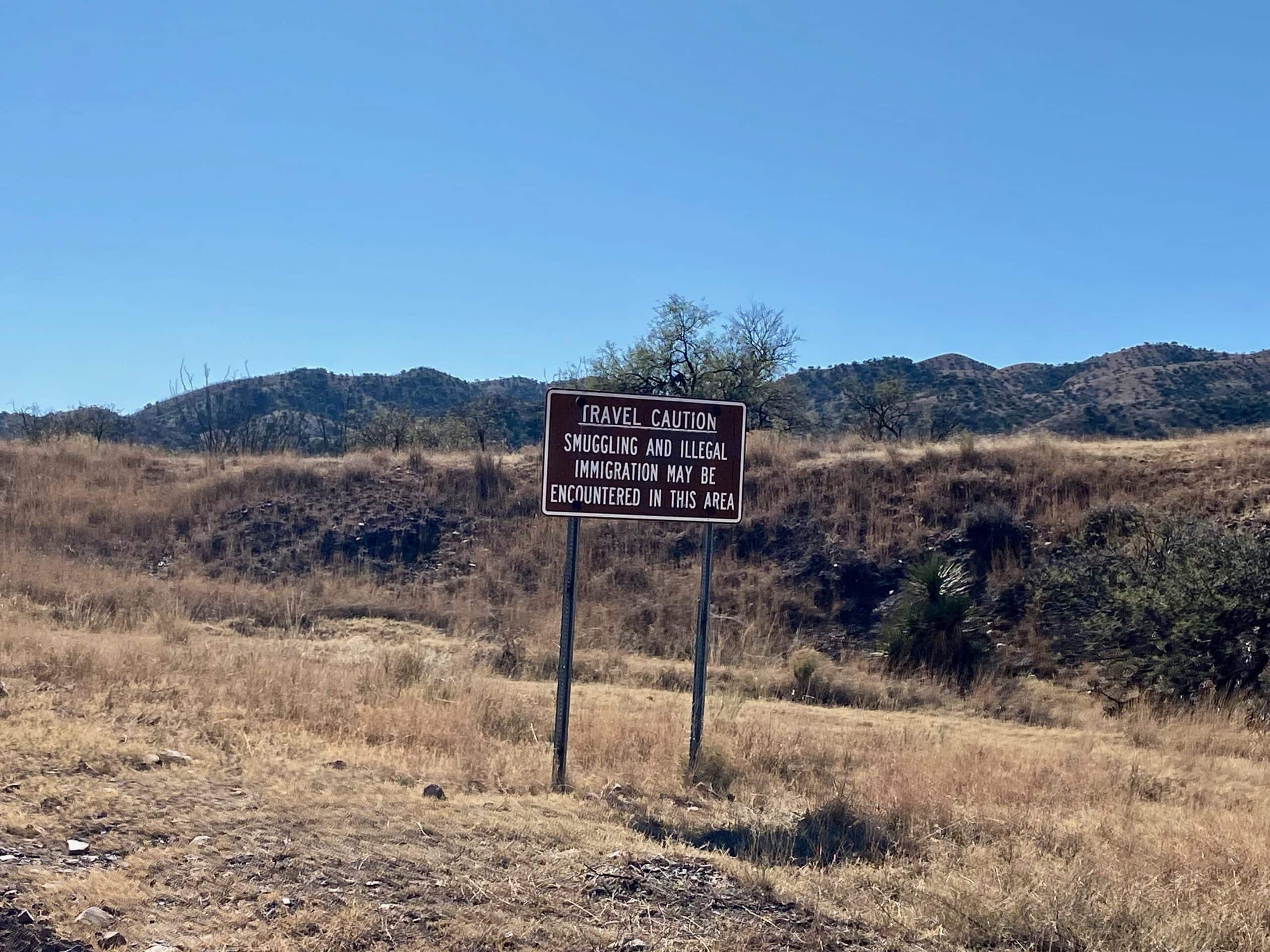 Caution sign along gravel portion of Ruby Road in the Coronado National Forest.