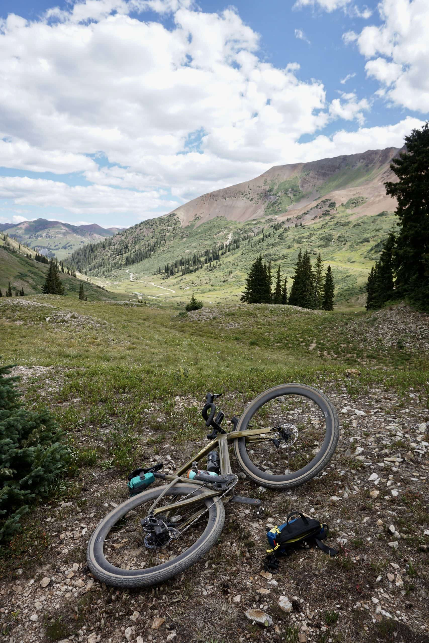 From Paradise Divide, looking towards Schofield Pass. Gravel bike on gravel road. Crested Butte, Colorado.