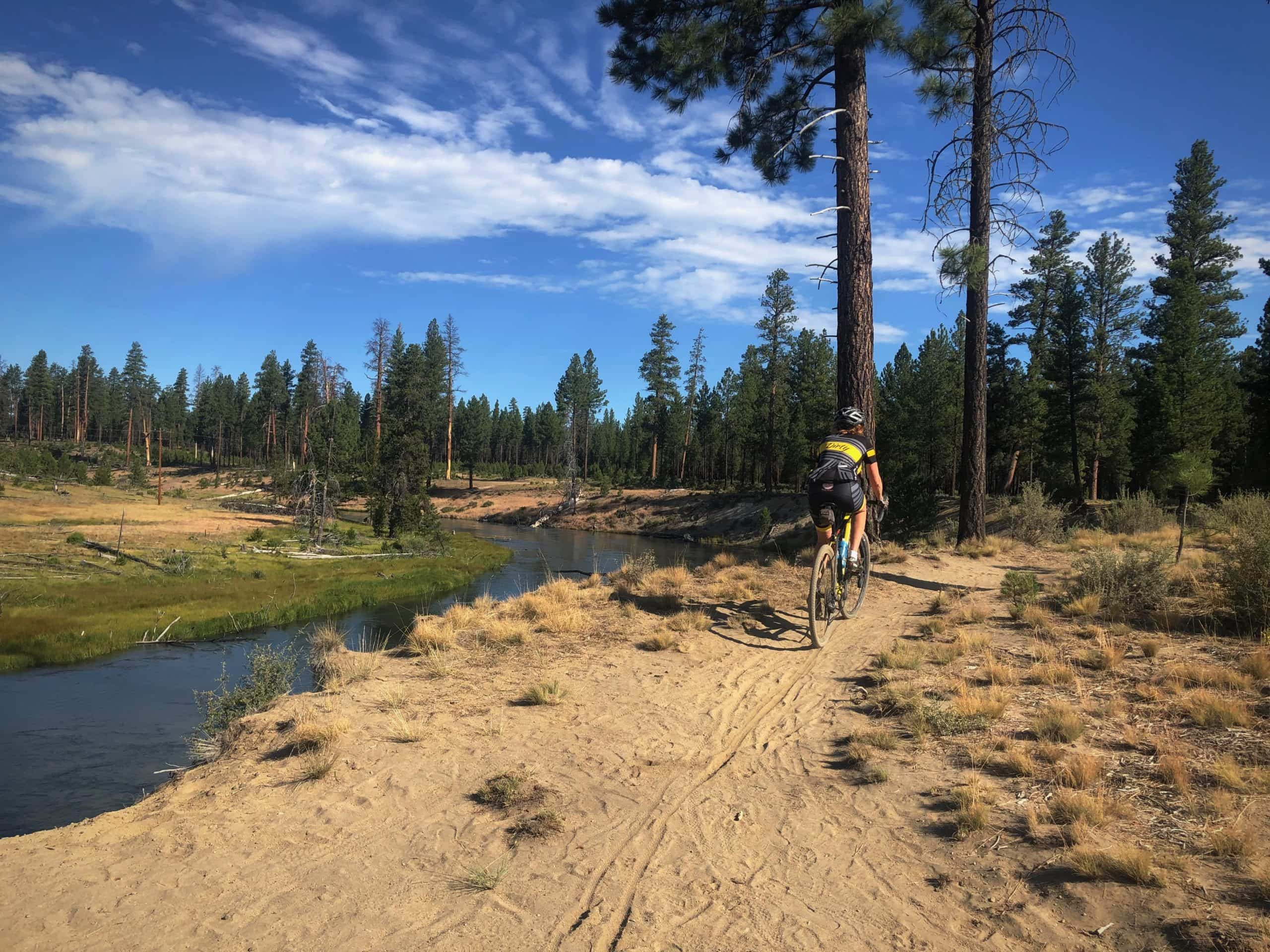 Woman gravel cyclist on dirt trail in LaPine State Park.