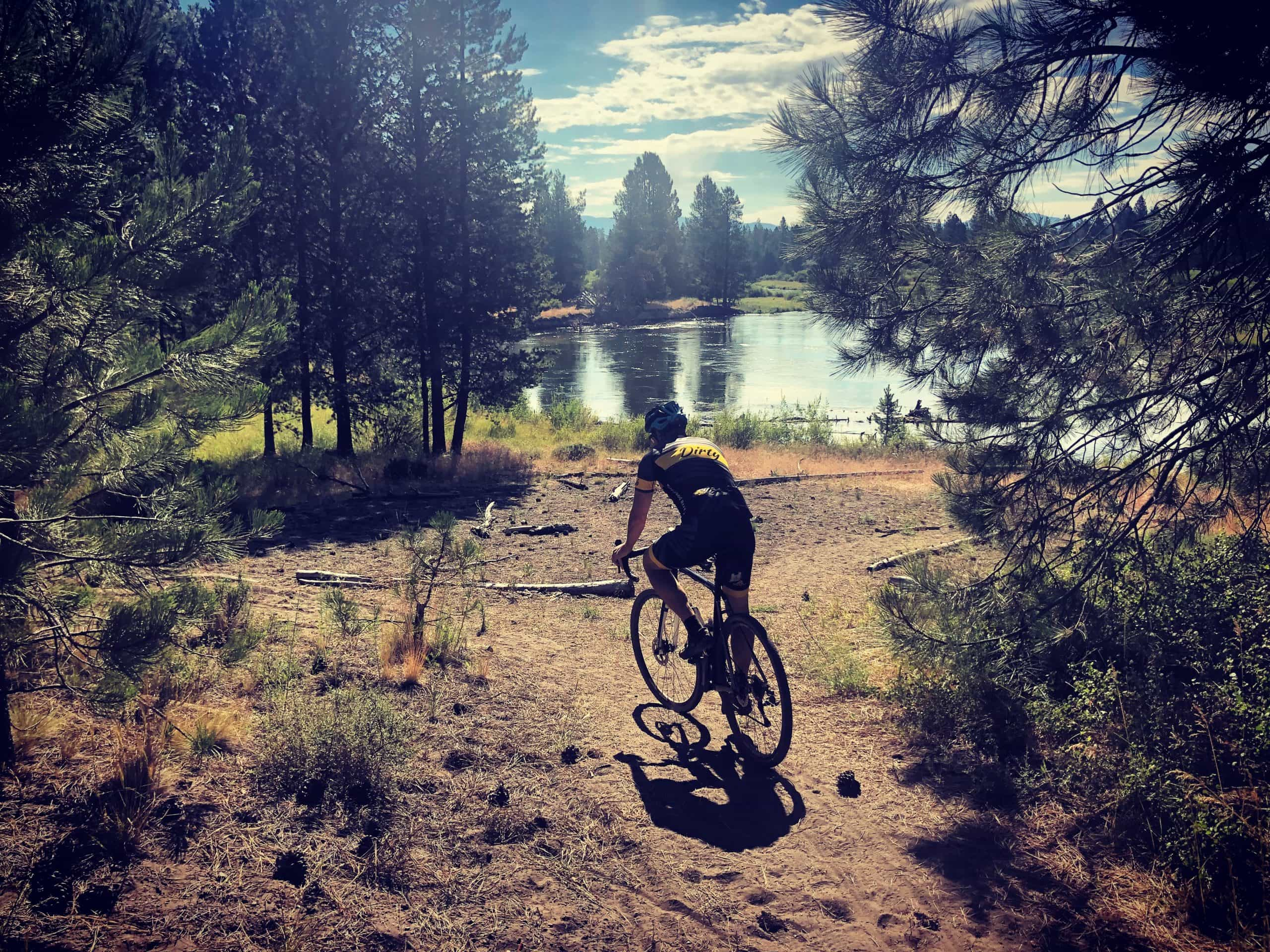 Gravel cyclist on dirt trail in LaPine State Park near Sunriver, OR.