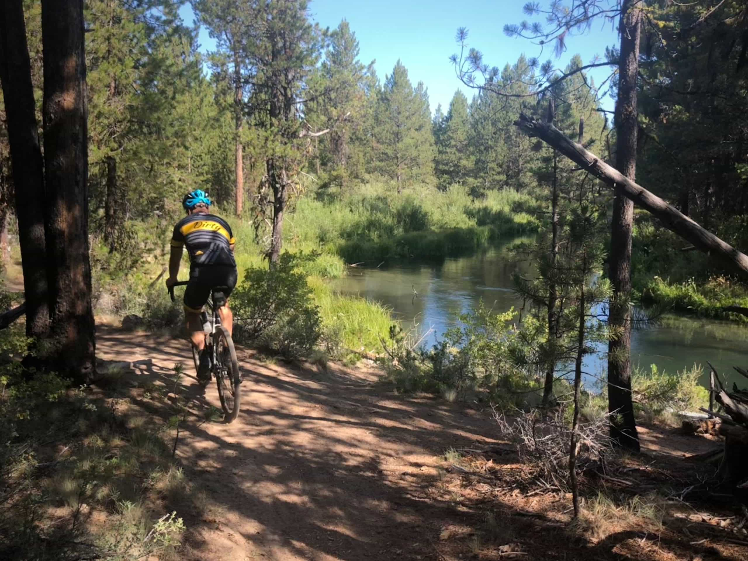 Cyclist on dirt trail in LaPine State park near Fall River.