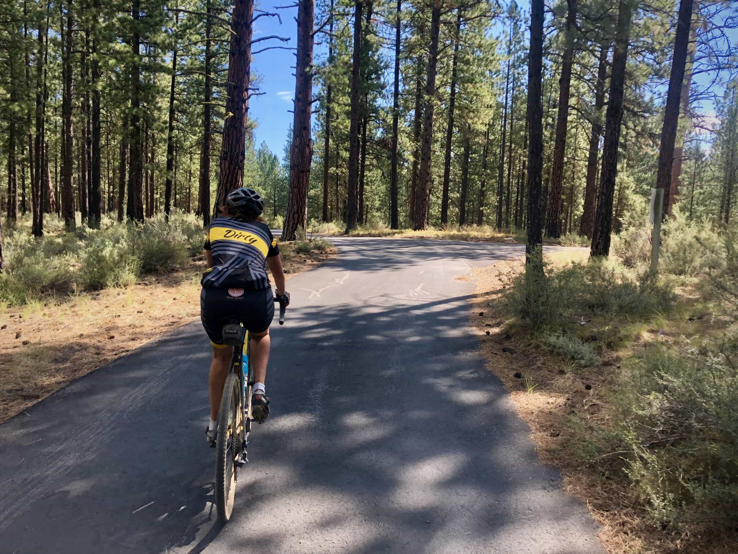 Woman cyclist on paved road in LaPine, Oregon.