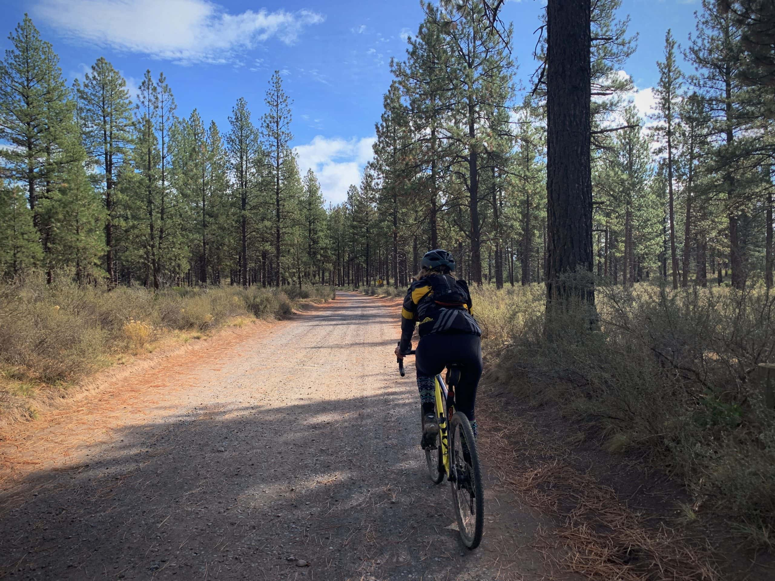 Gravel cyclist on gravel road leading to Lava Island Day Use area on the Deschutes River.