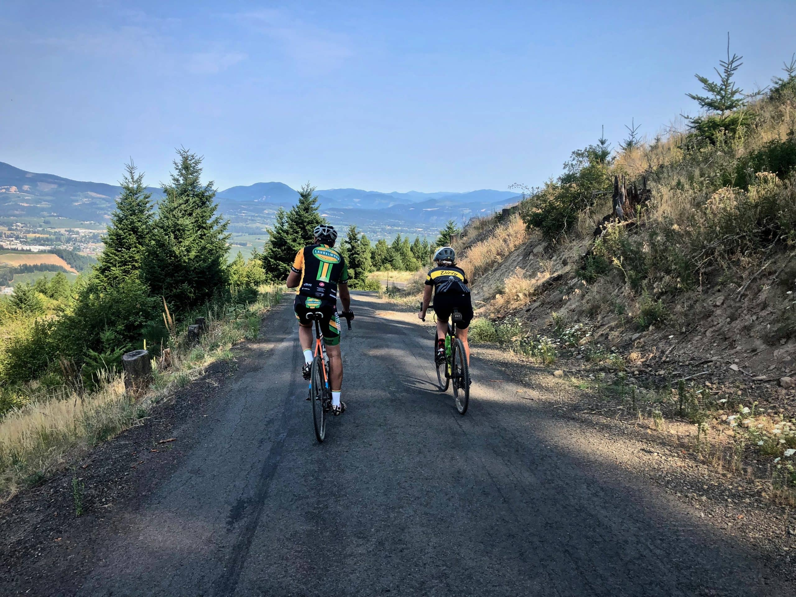 Cyclists on old paved road above Hood River, Oregon.
