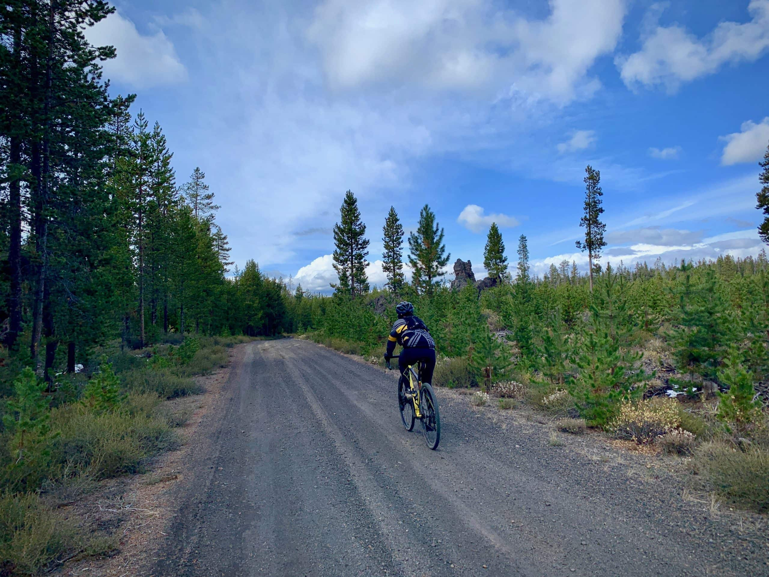 Cyclist on gravel road near China Hat in the Bend, Oregon area.