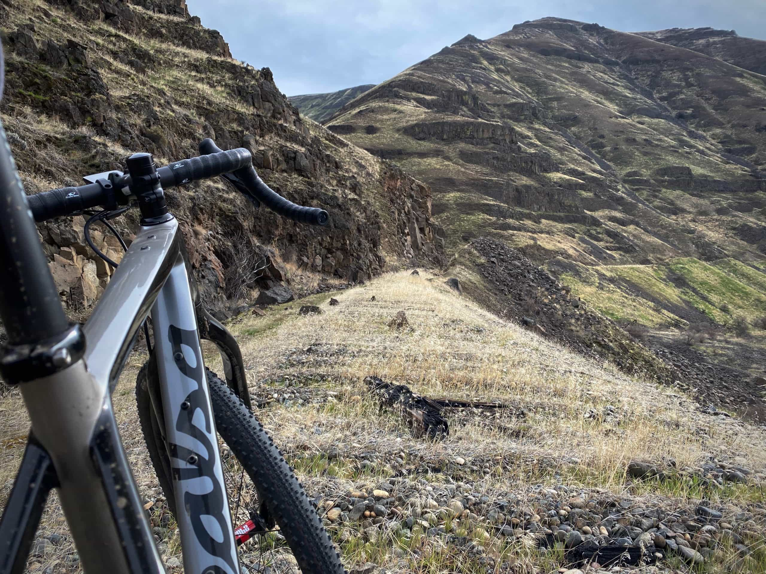 The rough single track trail with railway ties still in place along the Deschutes River just north of Macks Canyon.