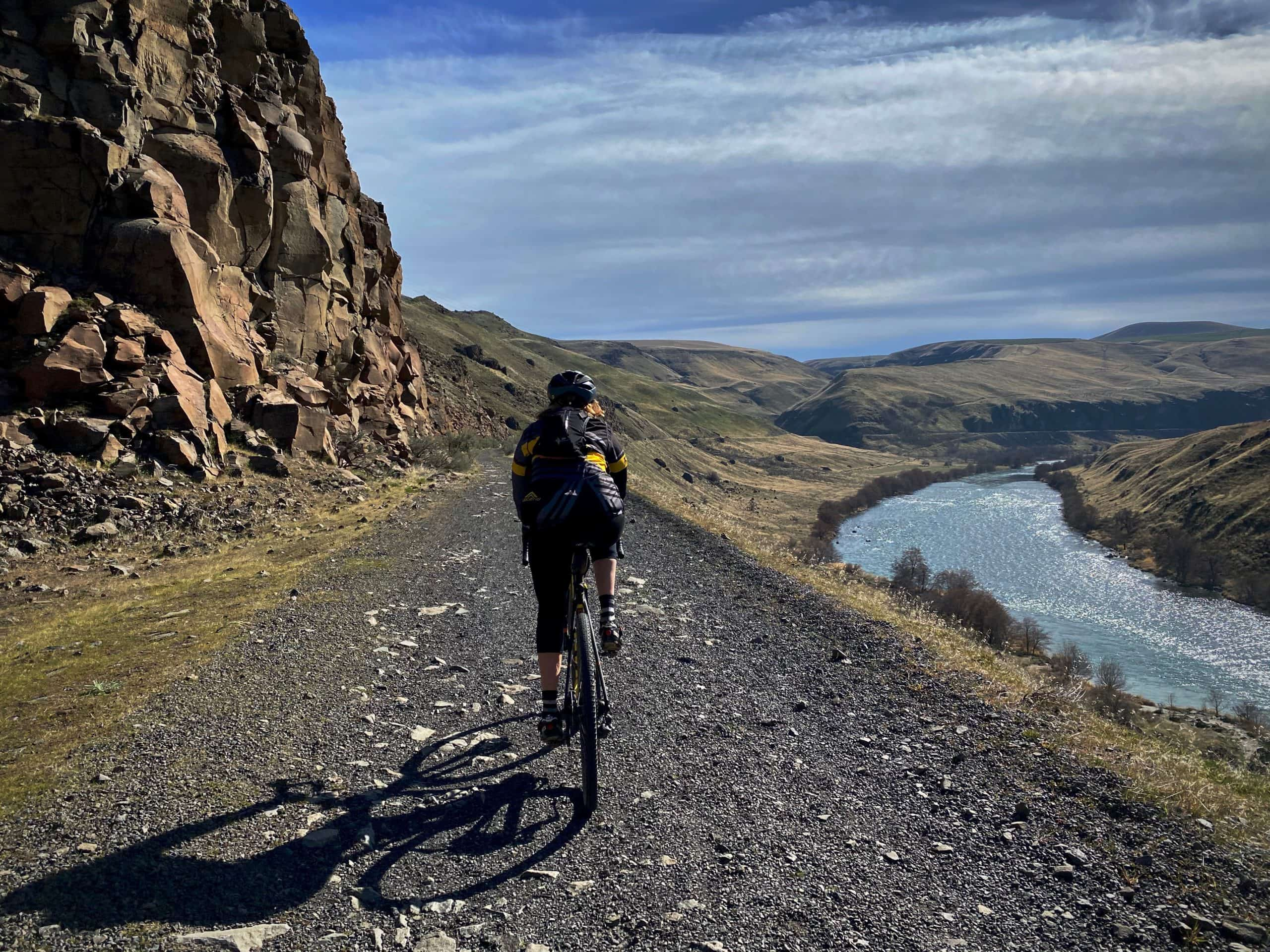 Gravel Girl on old chunky railway bed with the Deschutes river in the background near The Dalles, Oregon.