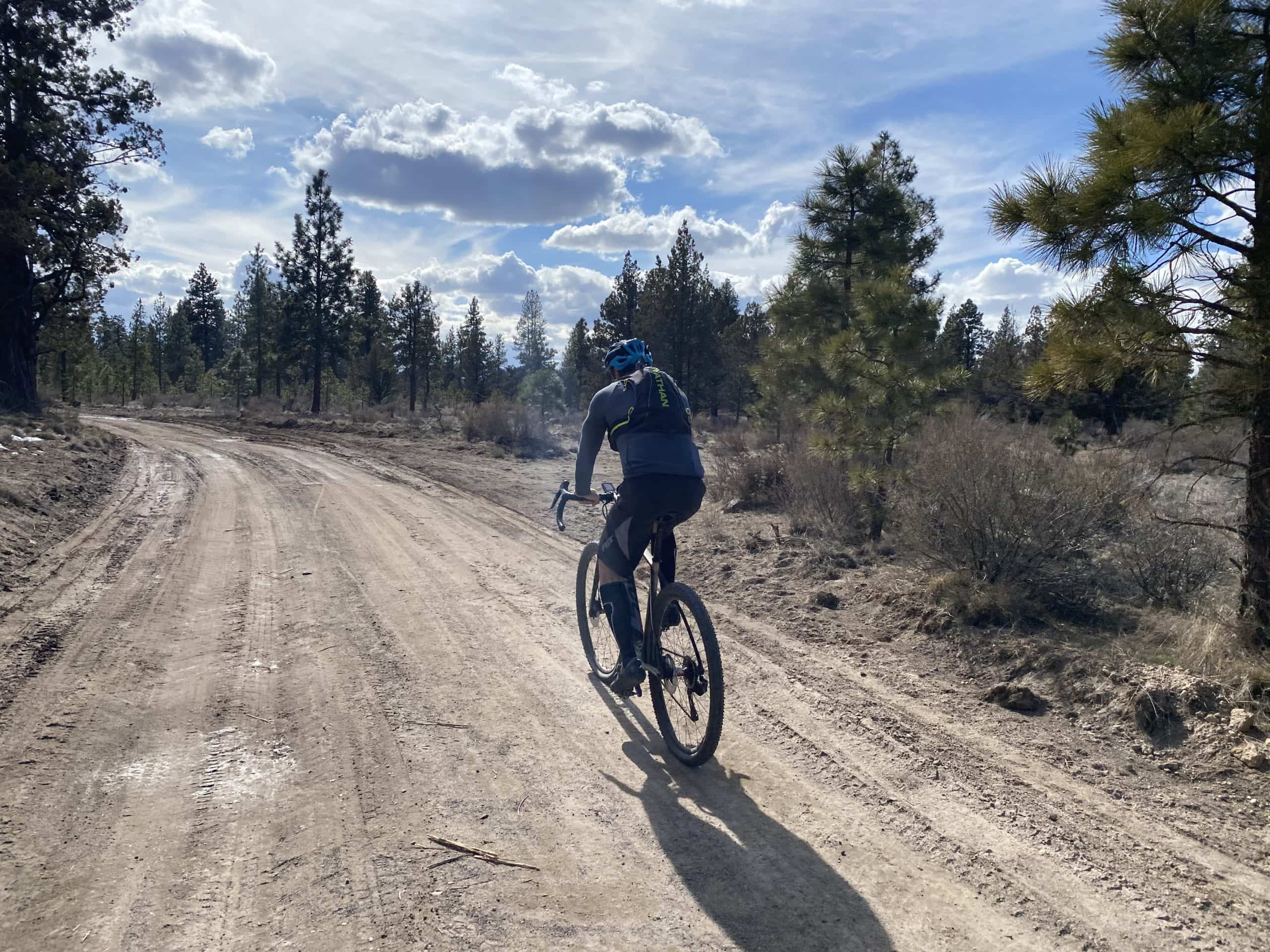 Cyclist on forest service road near Tumalo reservoir and the old feeder canal.