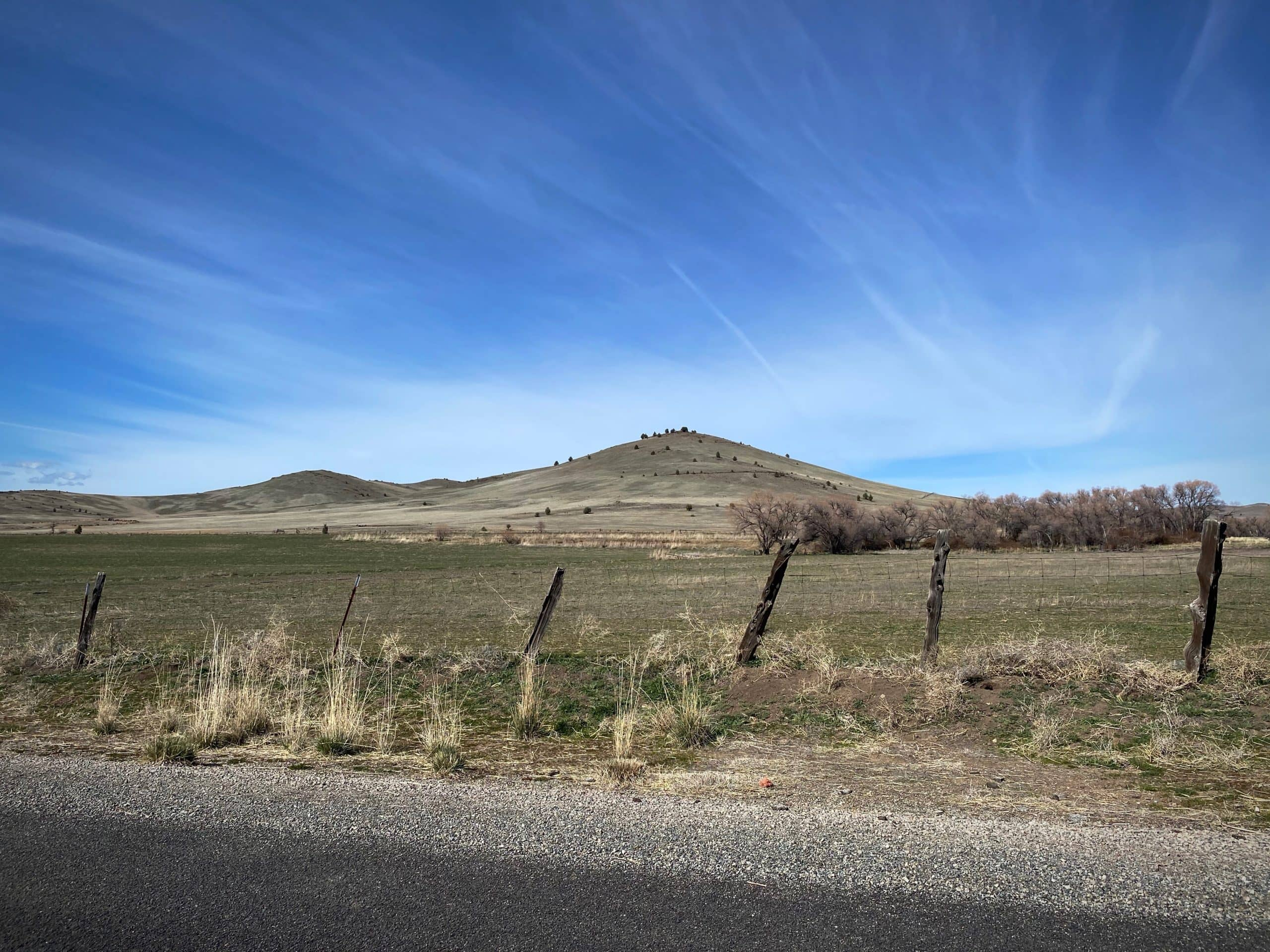 Fence posts. Butte. Farming field. Northern California.