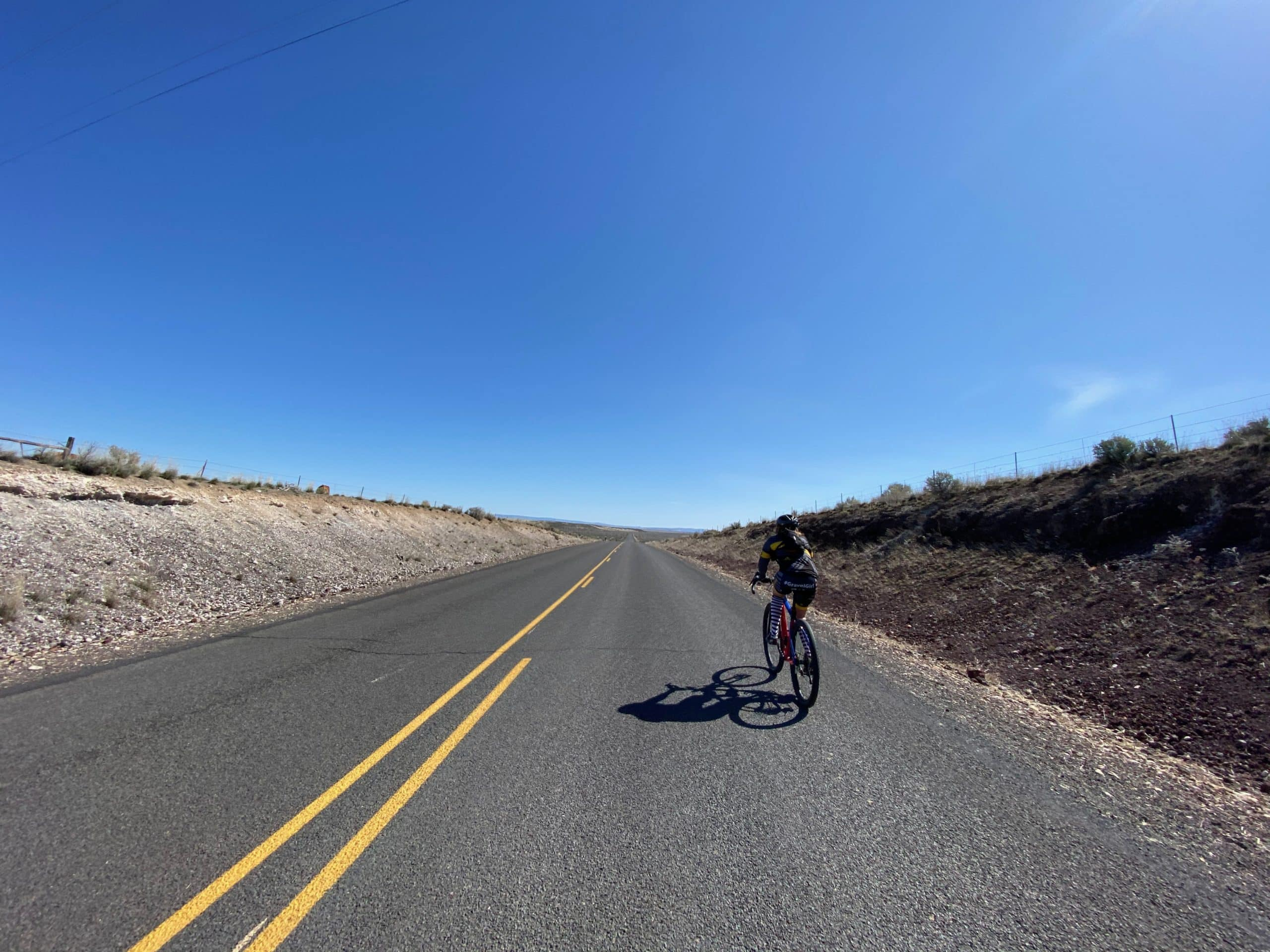 Cyclist on paved road near the Narrows, Oregon.