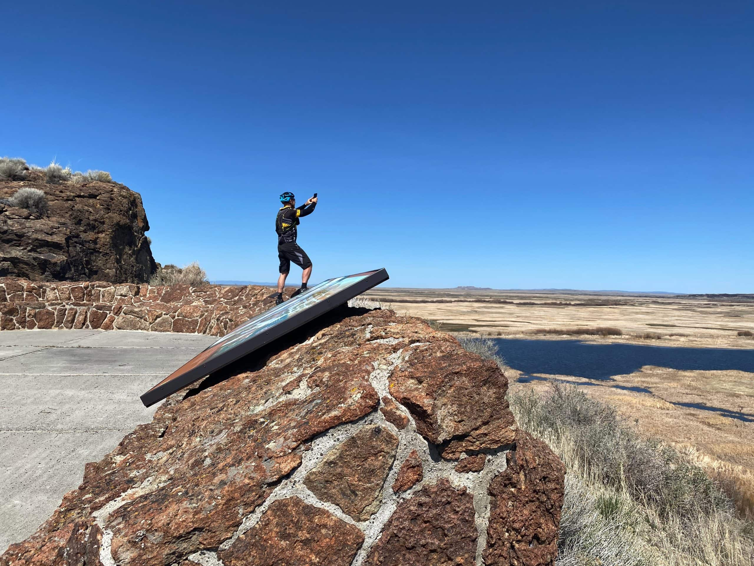 Captain O taking a picture from Buena Vista butte overlook in Malheur National Wildlife refuge.
