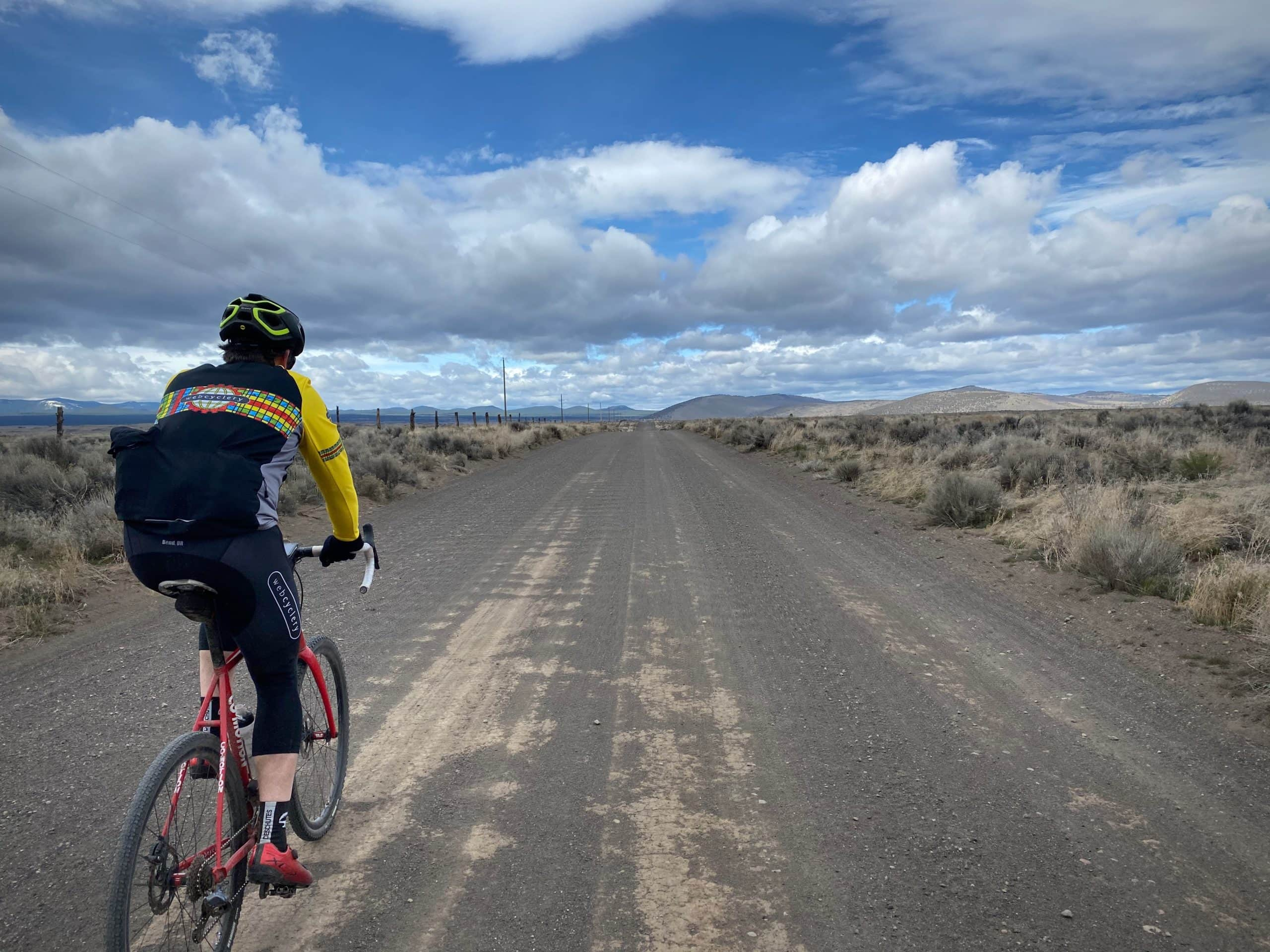 Gravel cyclist on Ford road near Bend, OR.
