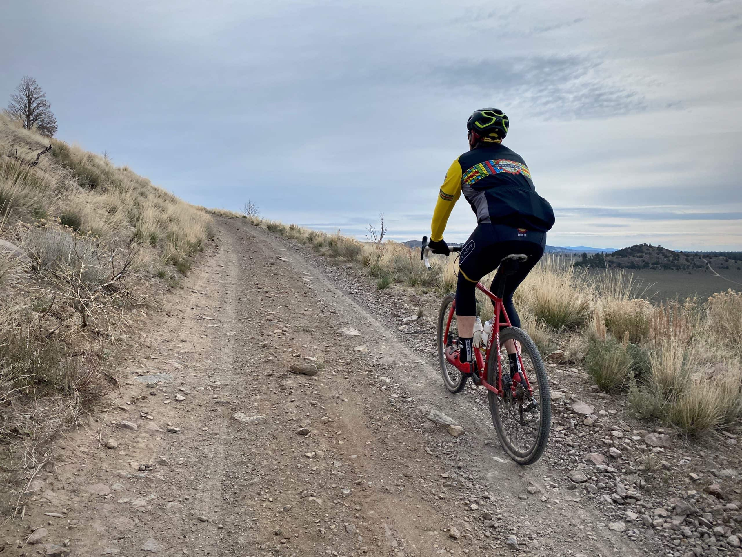 Cyclist on the rugged climb to the top of Pine Mountain near Bend, Oregon.